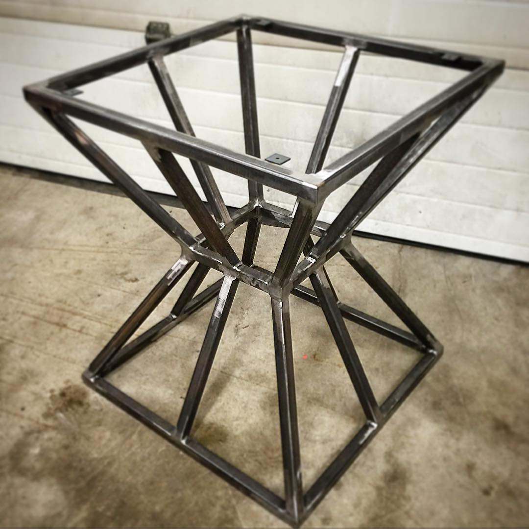 Geometric hour-glass table frame