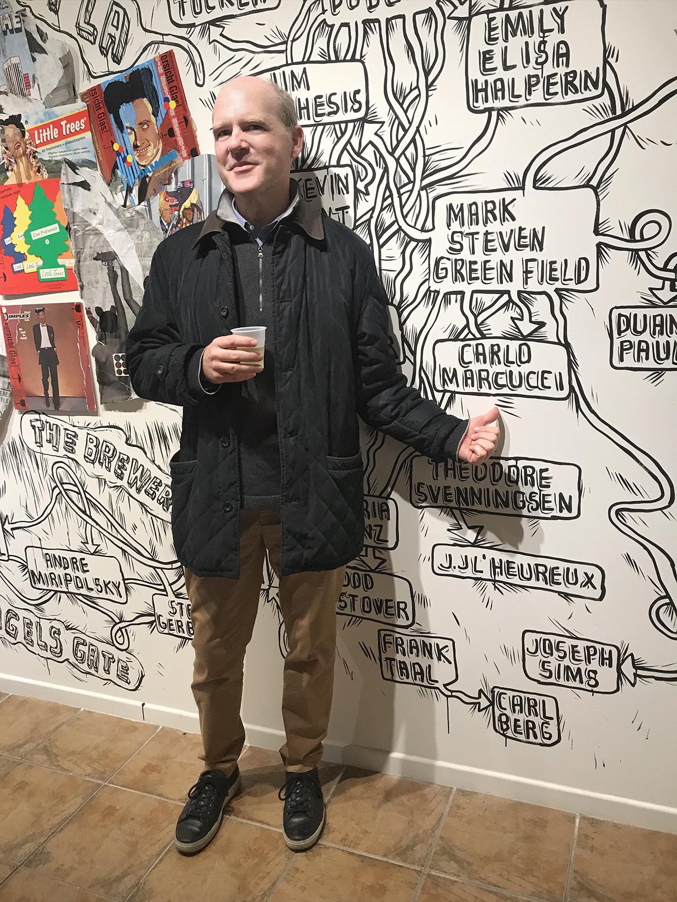 Artist Carlo Marcucci in front of mural