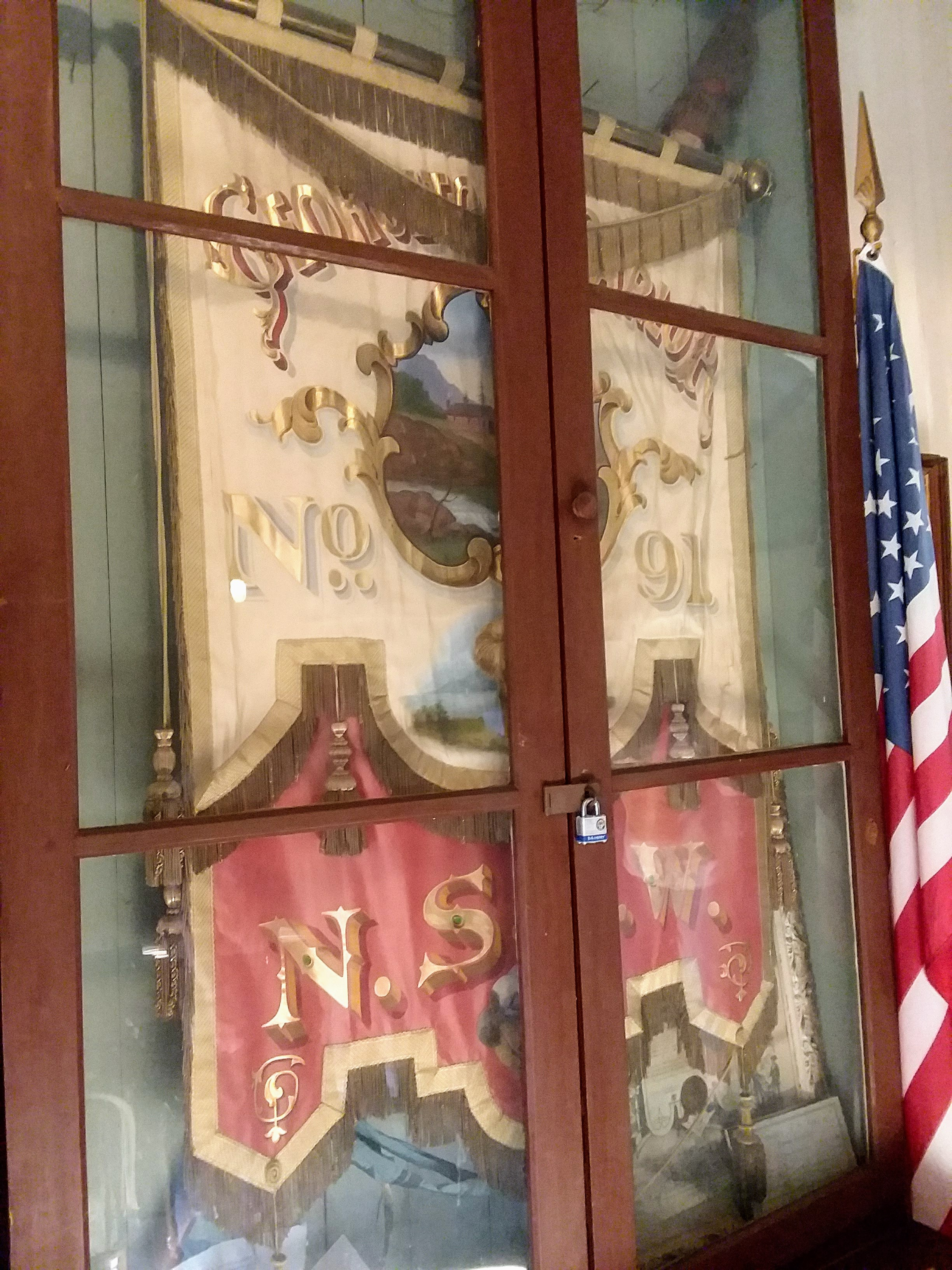 Native Sons of The Golden West banner from the 1980's on display.