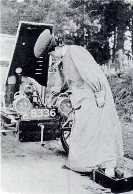 Dorothy Levitt working on her automobile.