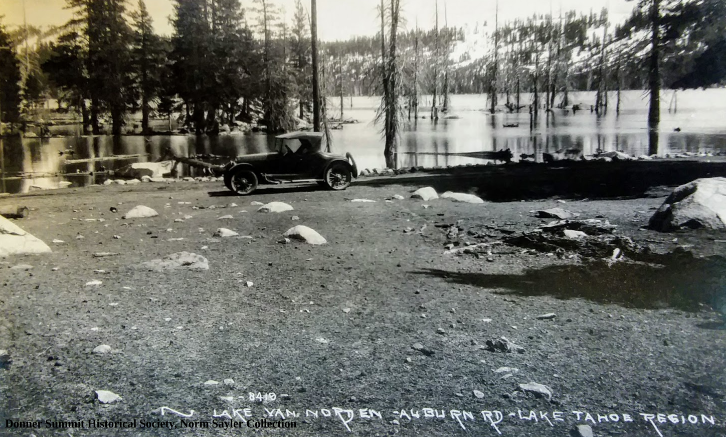 An automobile on the Lincoln Highway and a full Lake Van Norden.