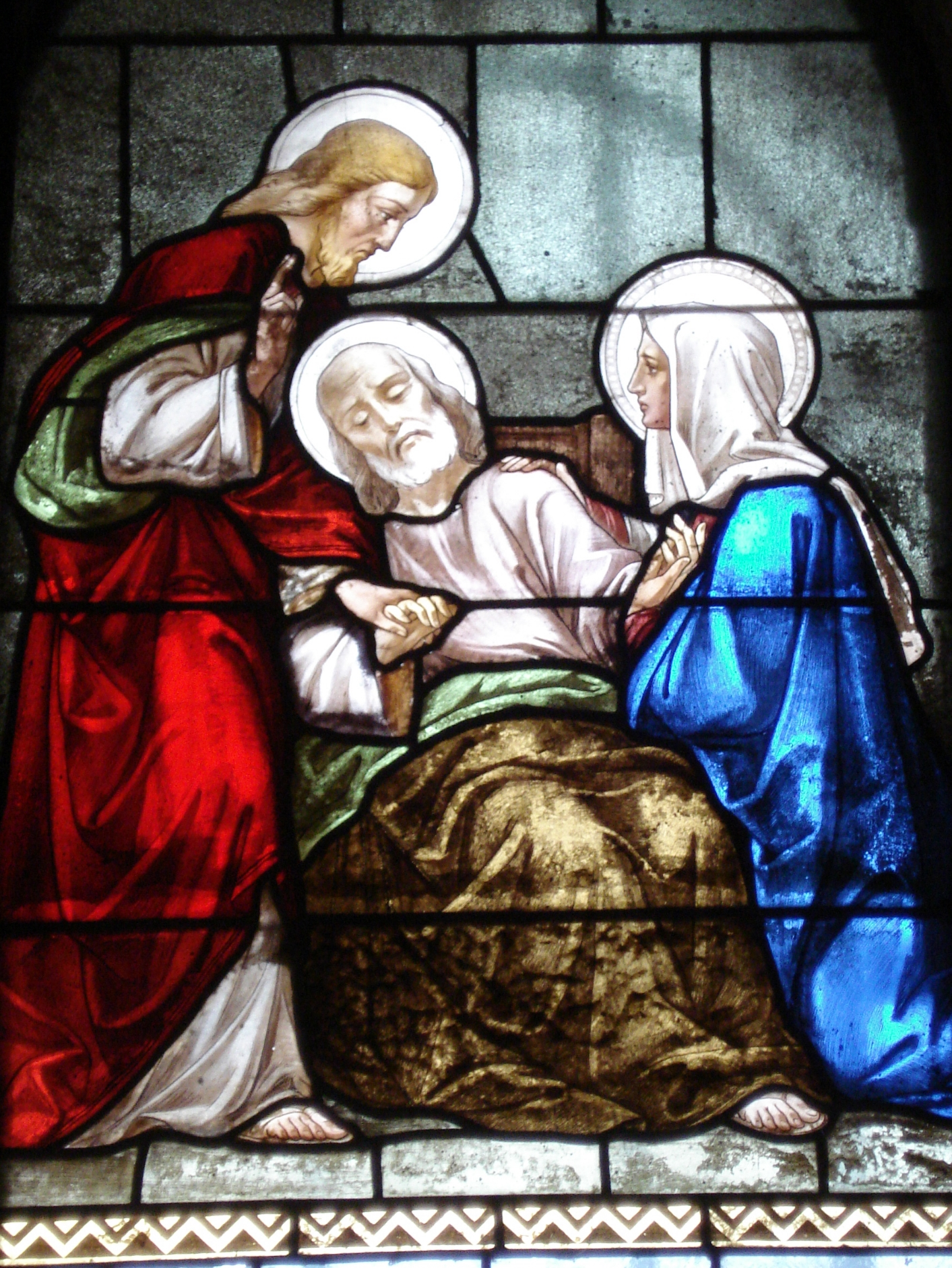The death of St. Joseph, comforted by Mary and Jesus - window in Nazareth, Israel