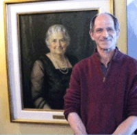 Bob Kann with a portrait of Lizzie Kander.