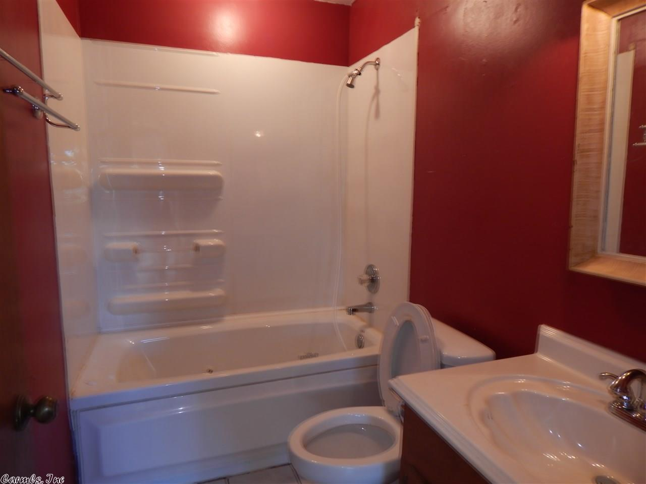 flipping_business_flip_house_before_picture_southern_arkansas_red_bathroom.jpeg