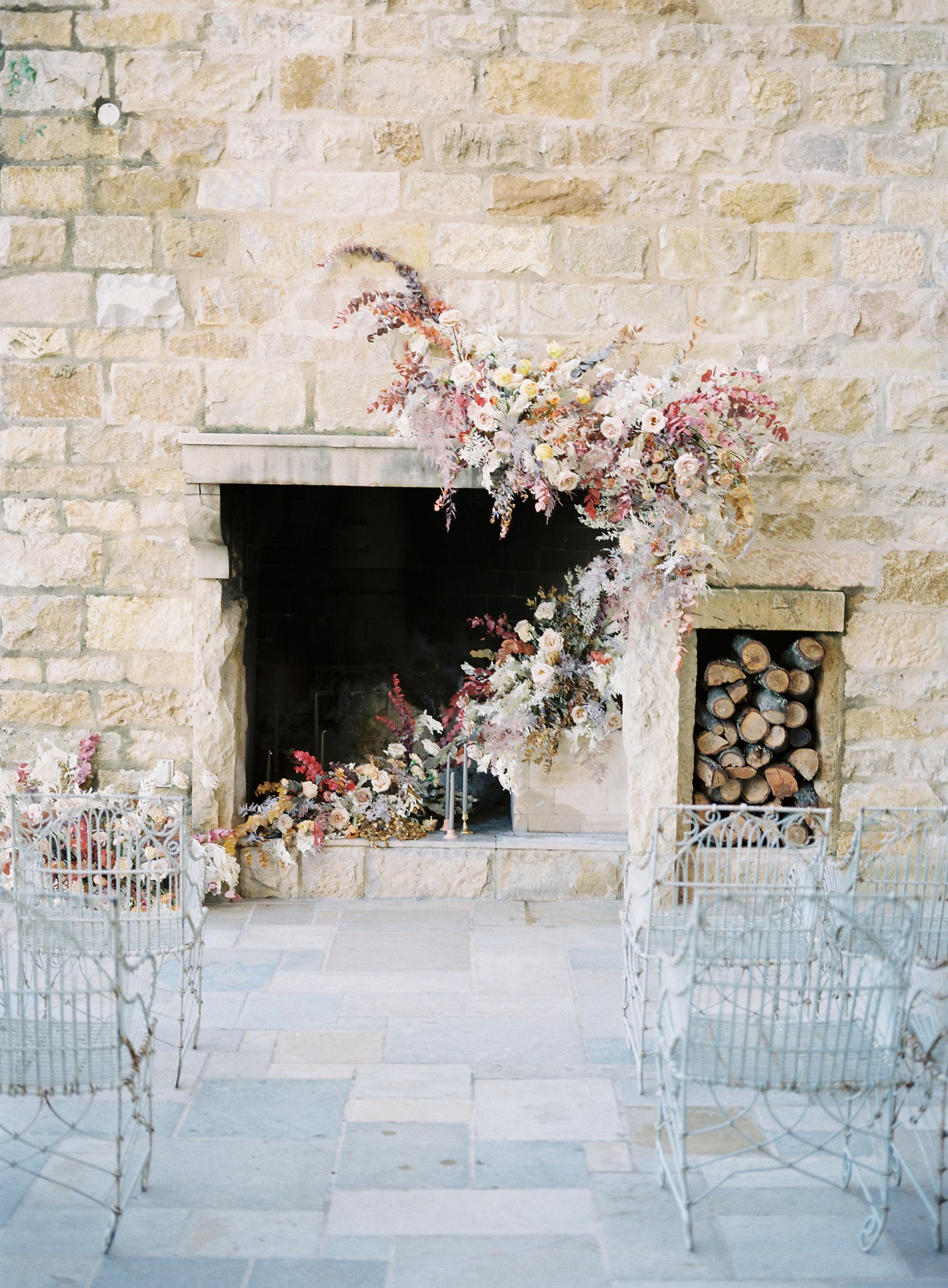 jessica-zimmerman-events-sunstone-ceremony-mantle-arrangement-fireplace.jpg