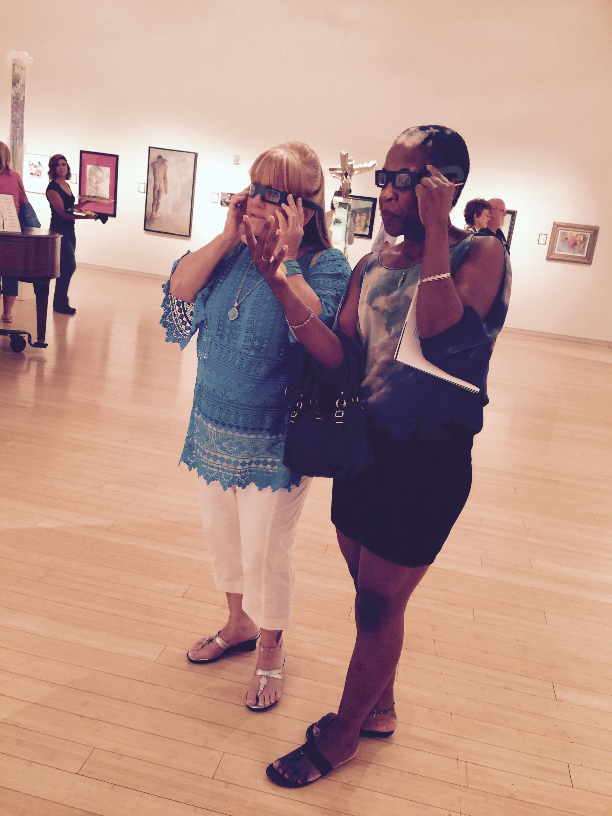 My mom and her friend Tari, looking at all the painting with 3D glasses they found.