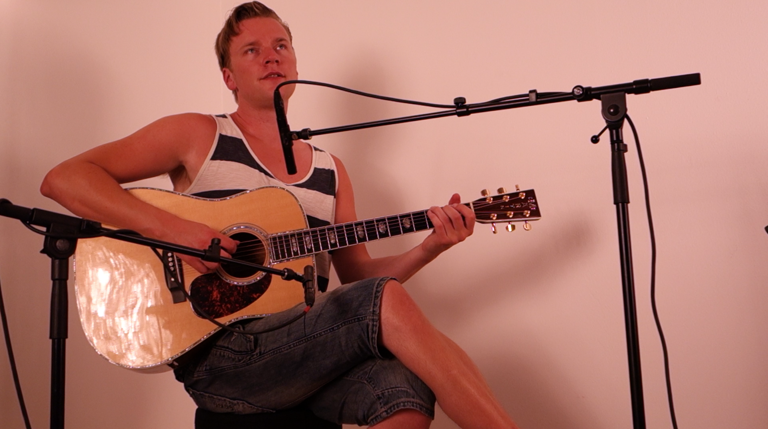 Recording an upcoming acoustic song.