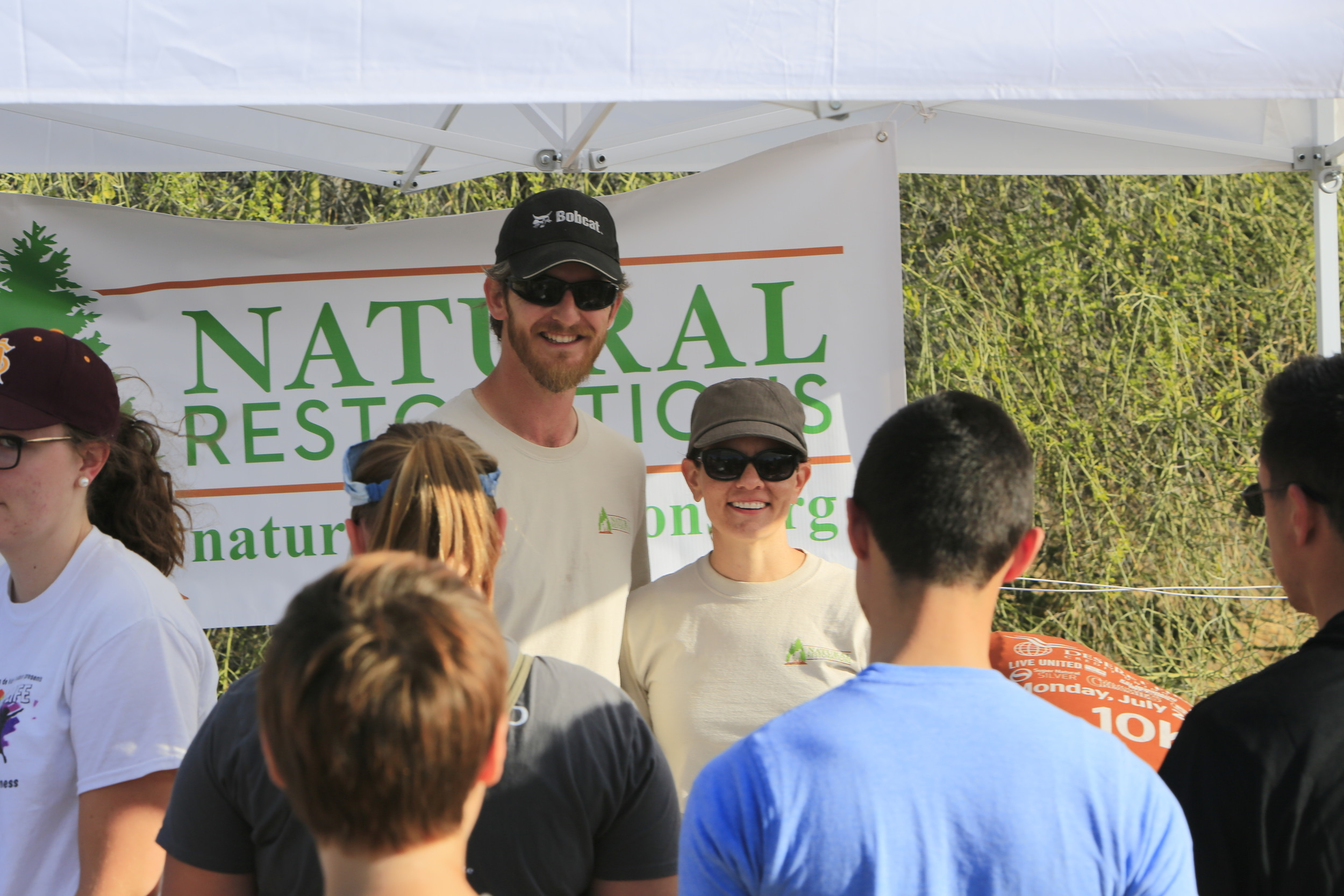 Justin & Nicole greeting volunteers