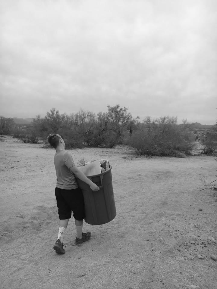 Nemo carrying garbage can.jpg