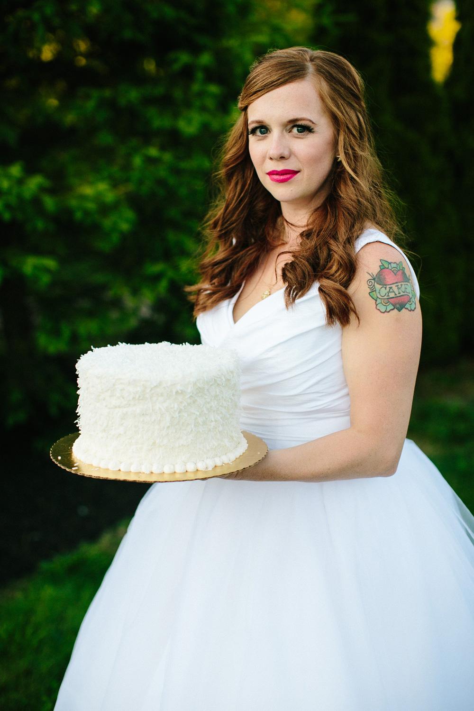 052-creative-tattooed-bridal-portrait-with-cake.jpg
