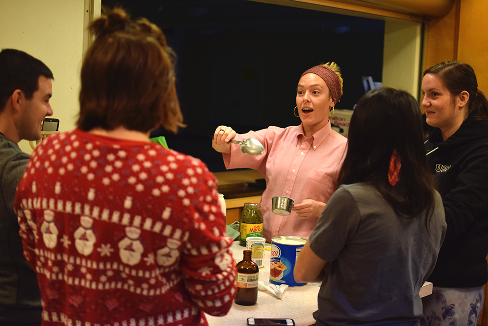 Bridget teaching how to make tamales
