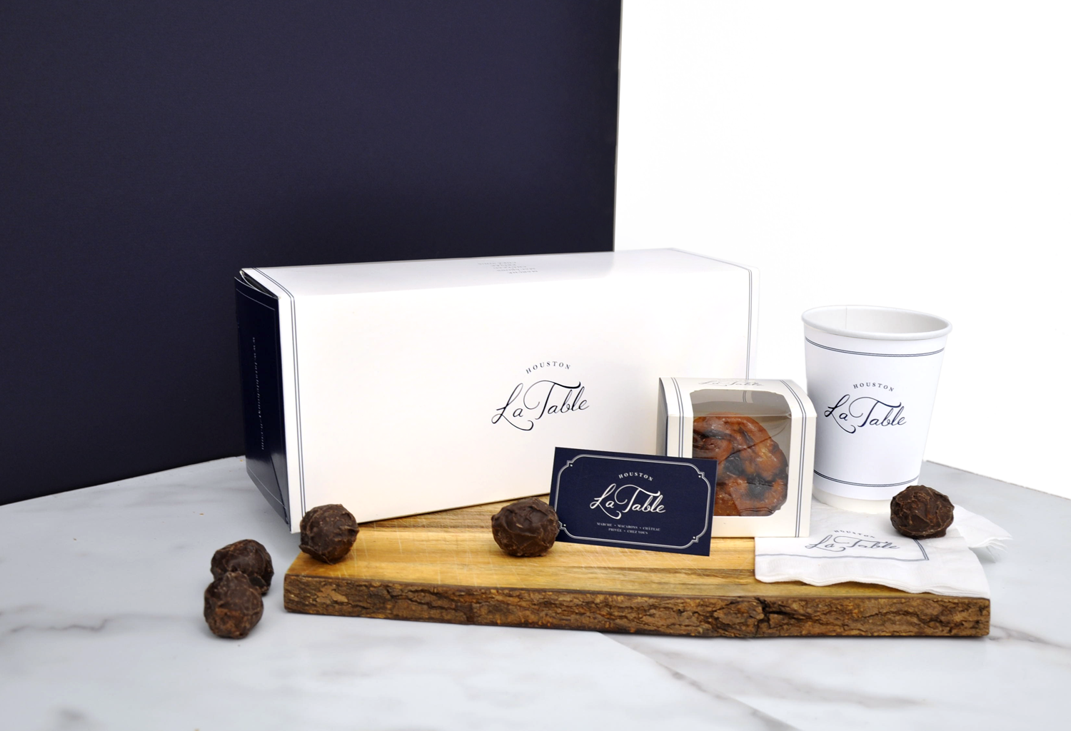 Selection of the packaging line up: collapsible boxes, napkins, hot cups and business cards