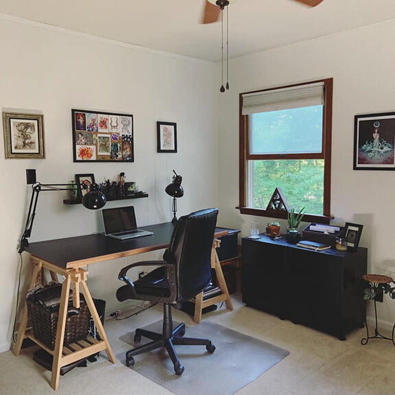 The Studio   I work out of a home office in Asheville, NC. A zen, clean space really helps me clear my mind and focus on my work. I love to collect art from other artists and hang them up in my space. Living in the Blue Ridge Mountains also makes for a great source of inspiration. Mountain trails, twisty trees, and local wildlife is all around me.
