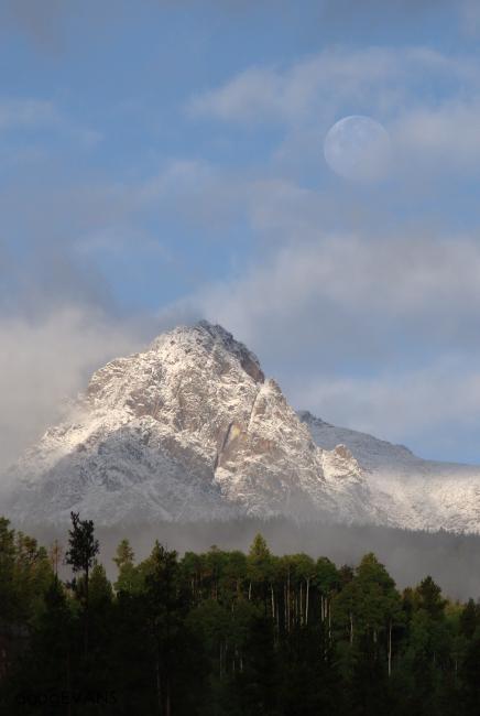 Late-September snows blanket Silverthorne Mountain under the harvest moon.