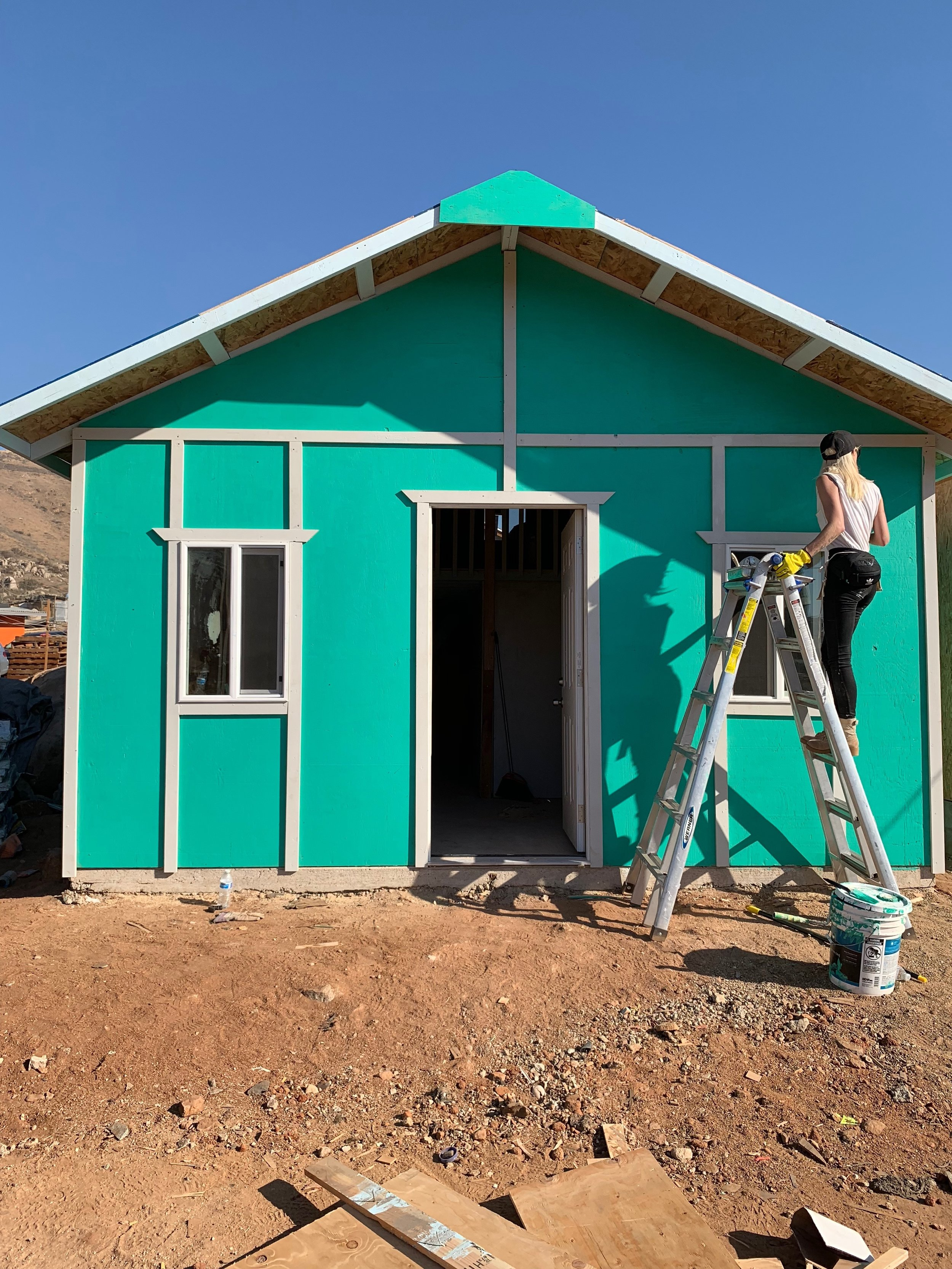 I painted this whole house by myself and the families were able to choose the color of their new home!