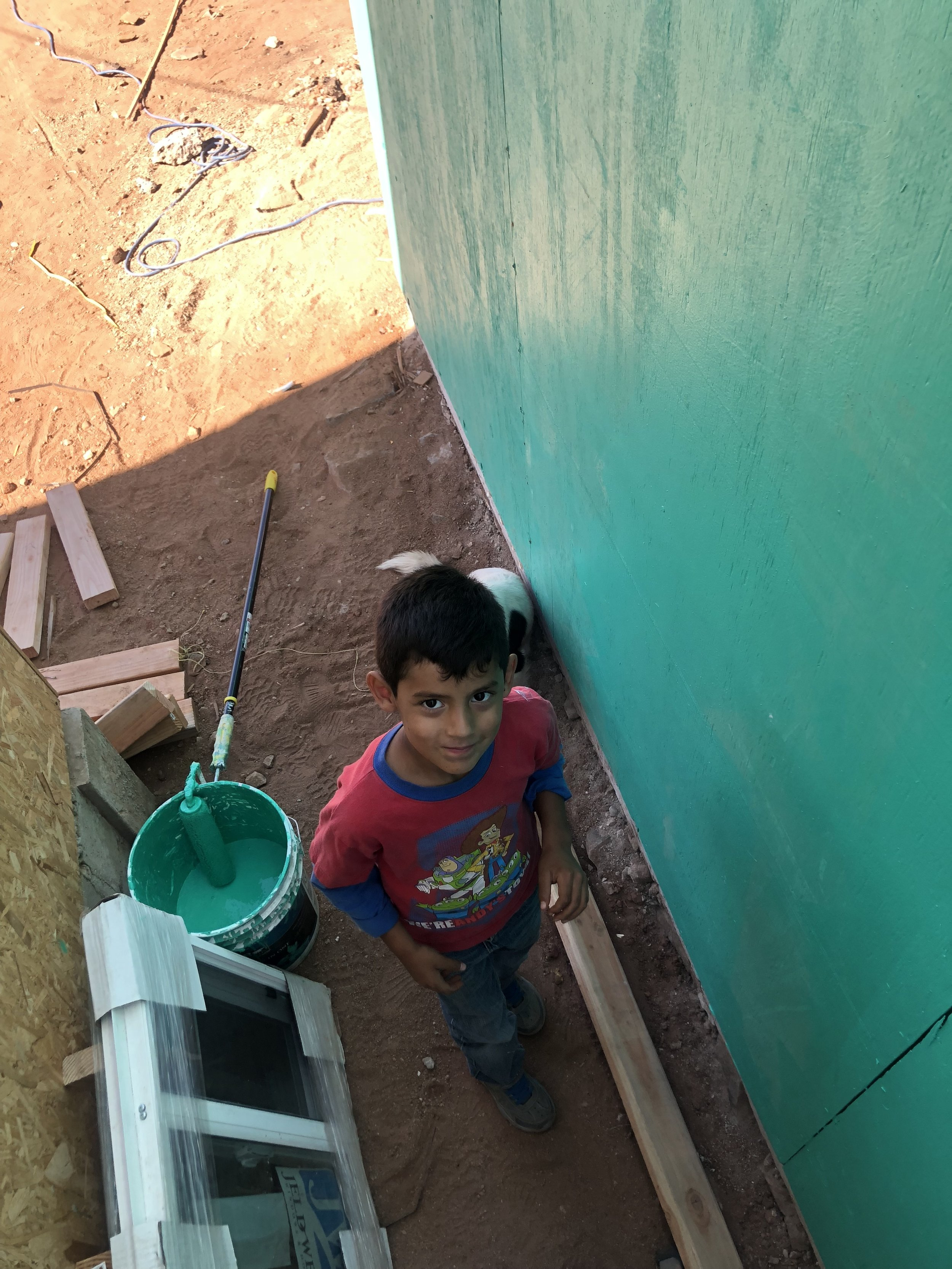He kept coming over trying to help me paint. I adored him! My Spanish is not too good so the language barrier was tough to converse, especially with a child, but the love and positivity we exchanged was an absolute universal language.