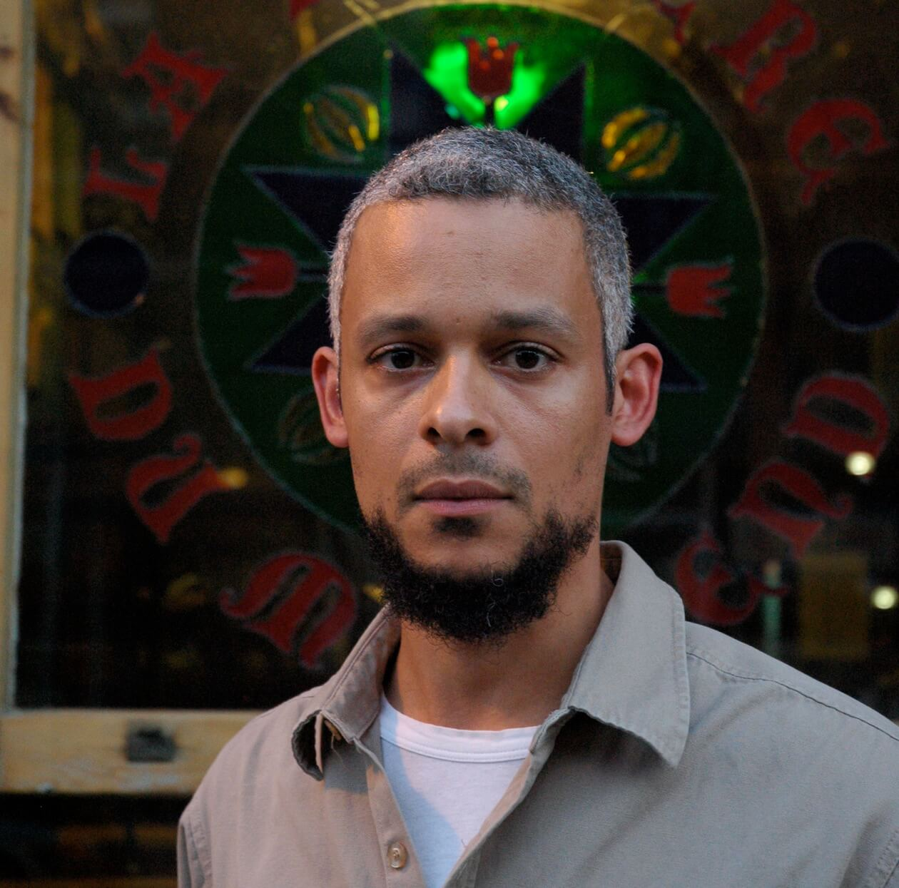Kaie - is a poet, novelist, and sound performer. His emphasis, when performing vocally and electronically, is on narrative, diaspora, and noise. His upcoming book of poetry, Magnetic Equator, will be published by Penguin Canada in Spring 2019. Kaie is the author of two sound-poetry recordings, two books of poetry, and one novel, Accordéon, which was nominated for the Amazon First Novel Award. He is now completing his first collection of short fiction, which leaps time and latitude, and divides its consciousness between North America and the Caribbean.Kaie will be featuring at the APS Sydney Finals.Join Kaie at two events; A Chat with Kaie Kellough and Masterclass with Kaie Kellough.