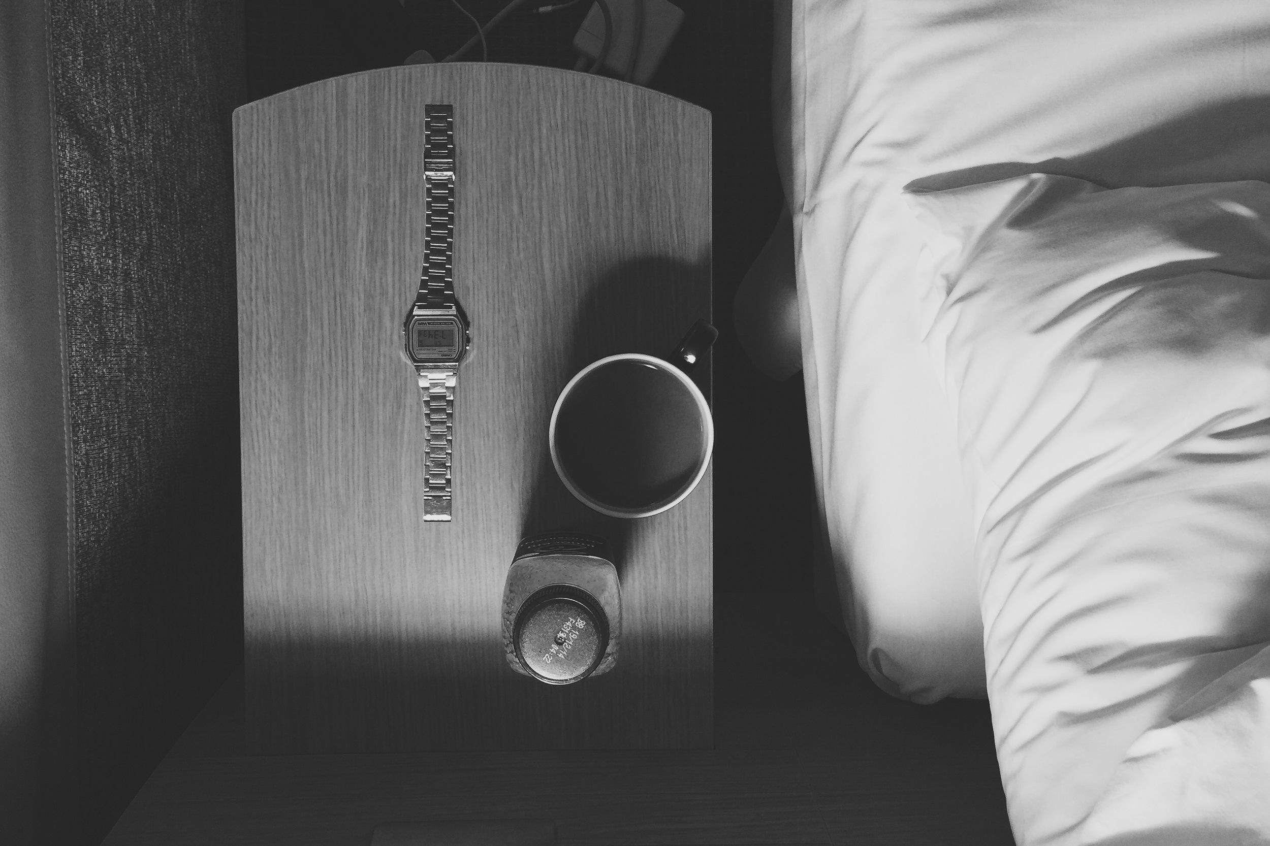 My bedside essentials : Casio Ltd Edition Gold, Innocent Antioxidant Drink, Cup of English Breakfast Tea.
