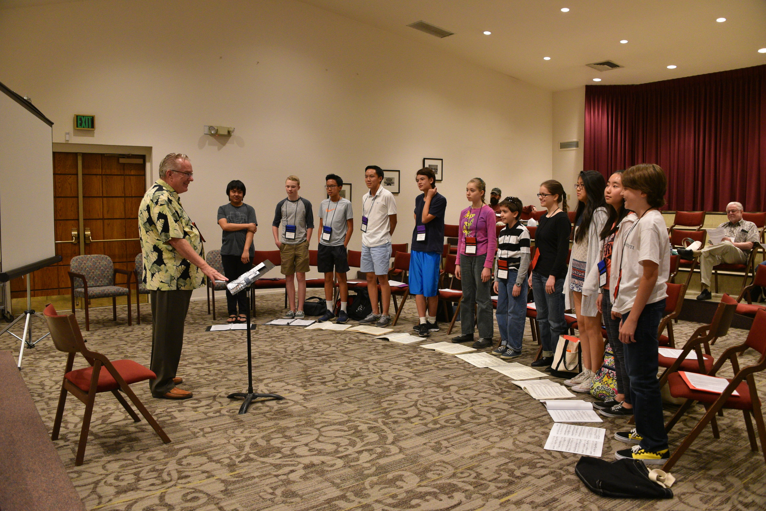 Don Conducting Choir with Blue, Purple, and Red Groups.JPG