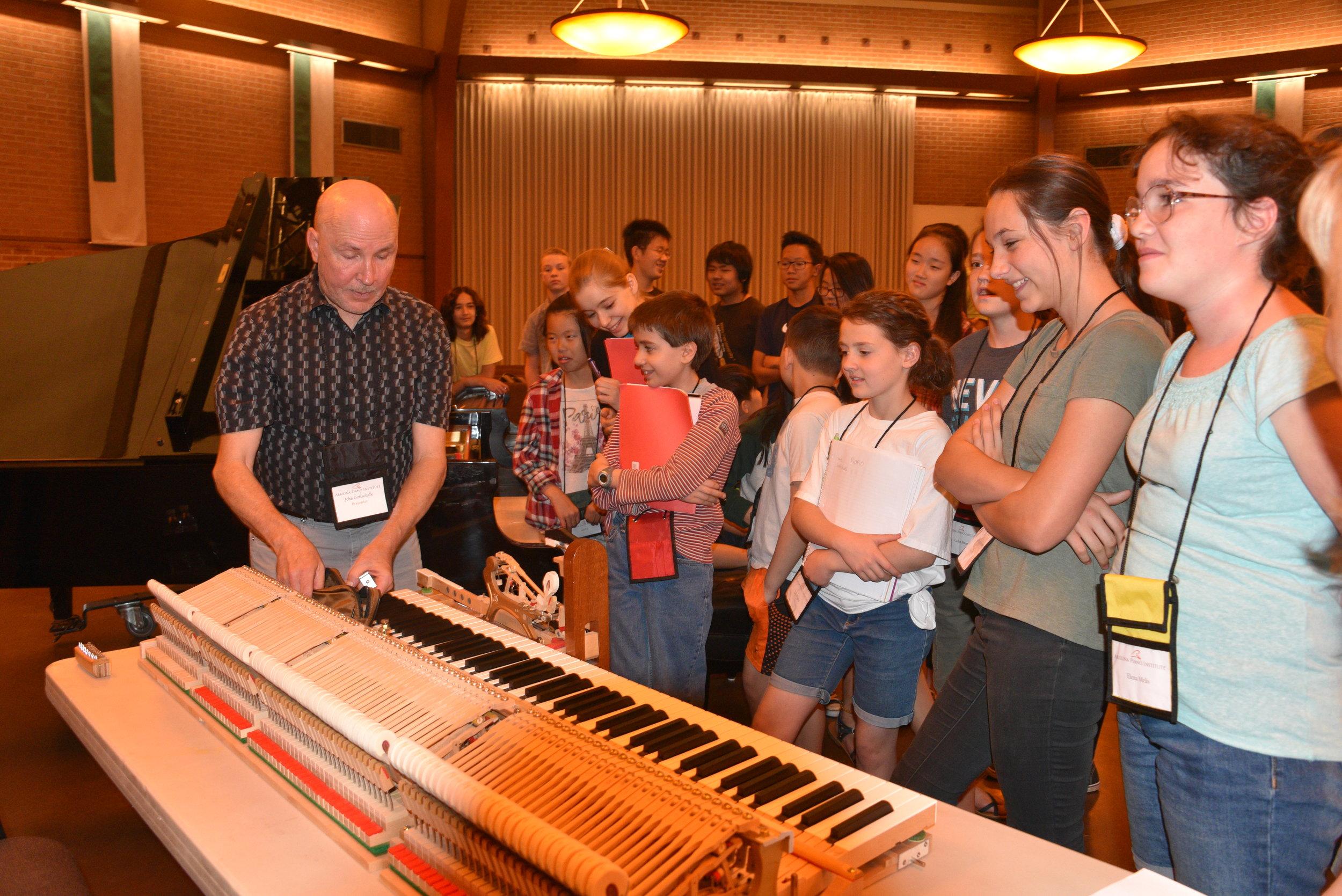 John Showing Action to Kids.JPG