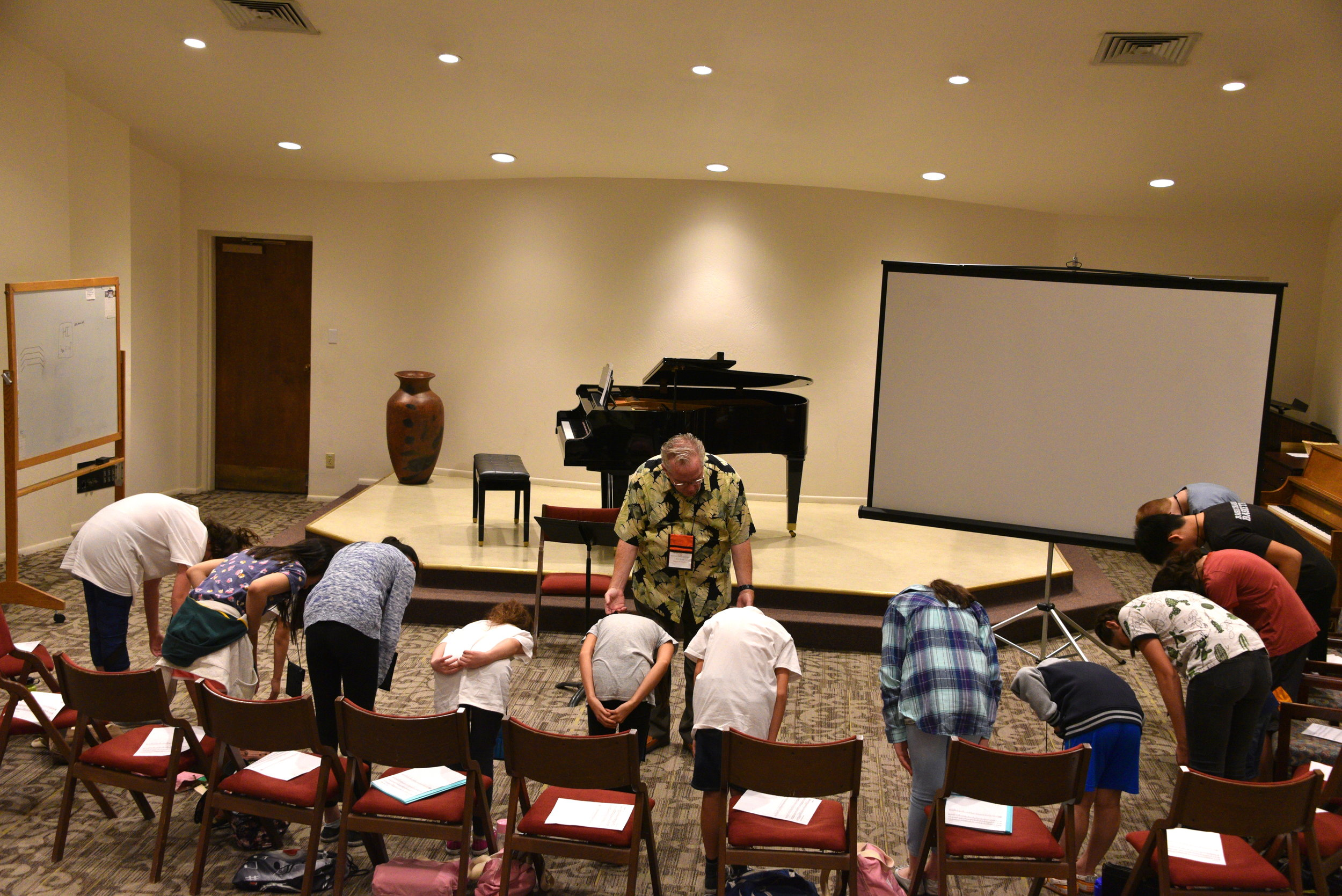 Don Bowing with Students.JPG