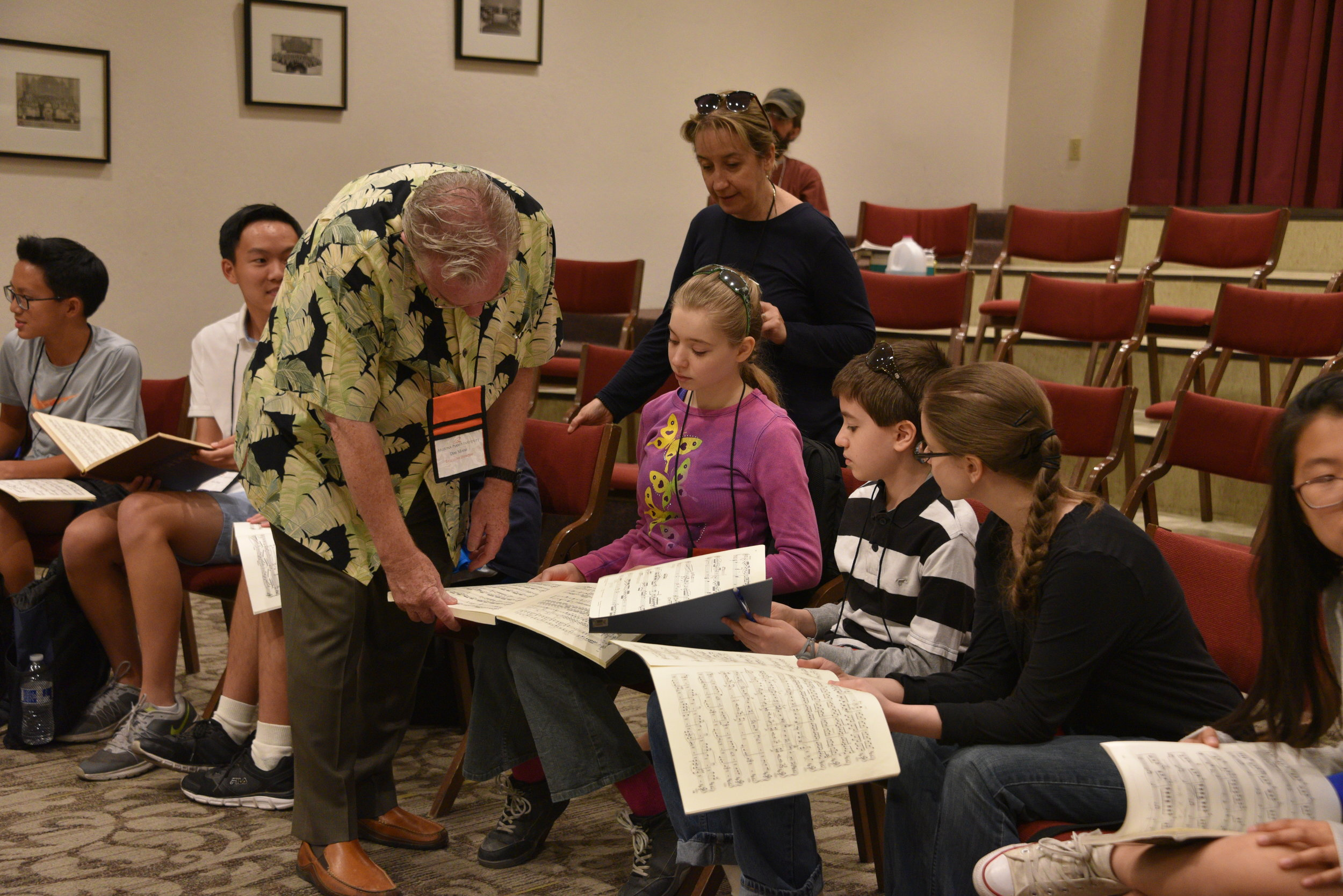 Don Looking at a Score with Safron Kids.JPG