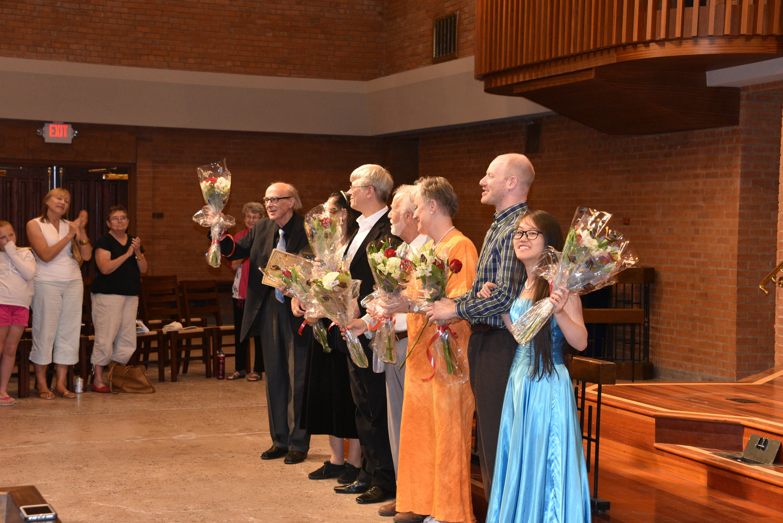 Faculty Accepting Flowers on Stage.JPG