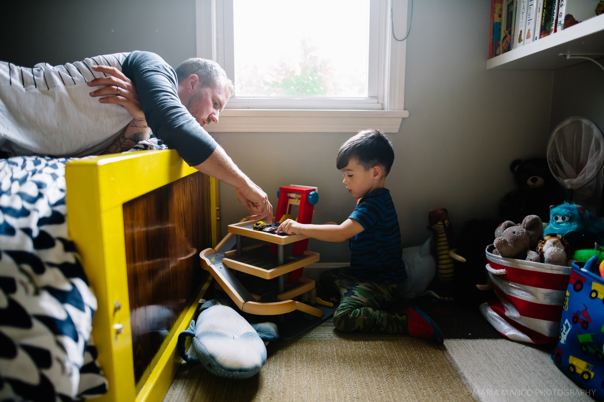 ©MariaManco _ Father and son playing together in child's room