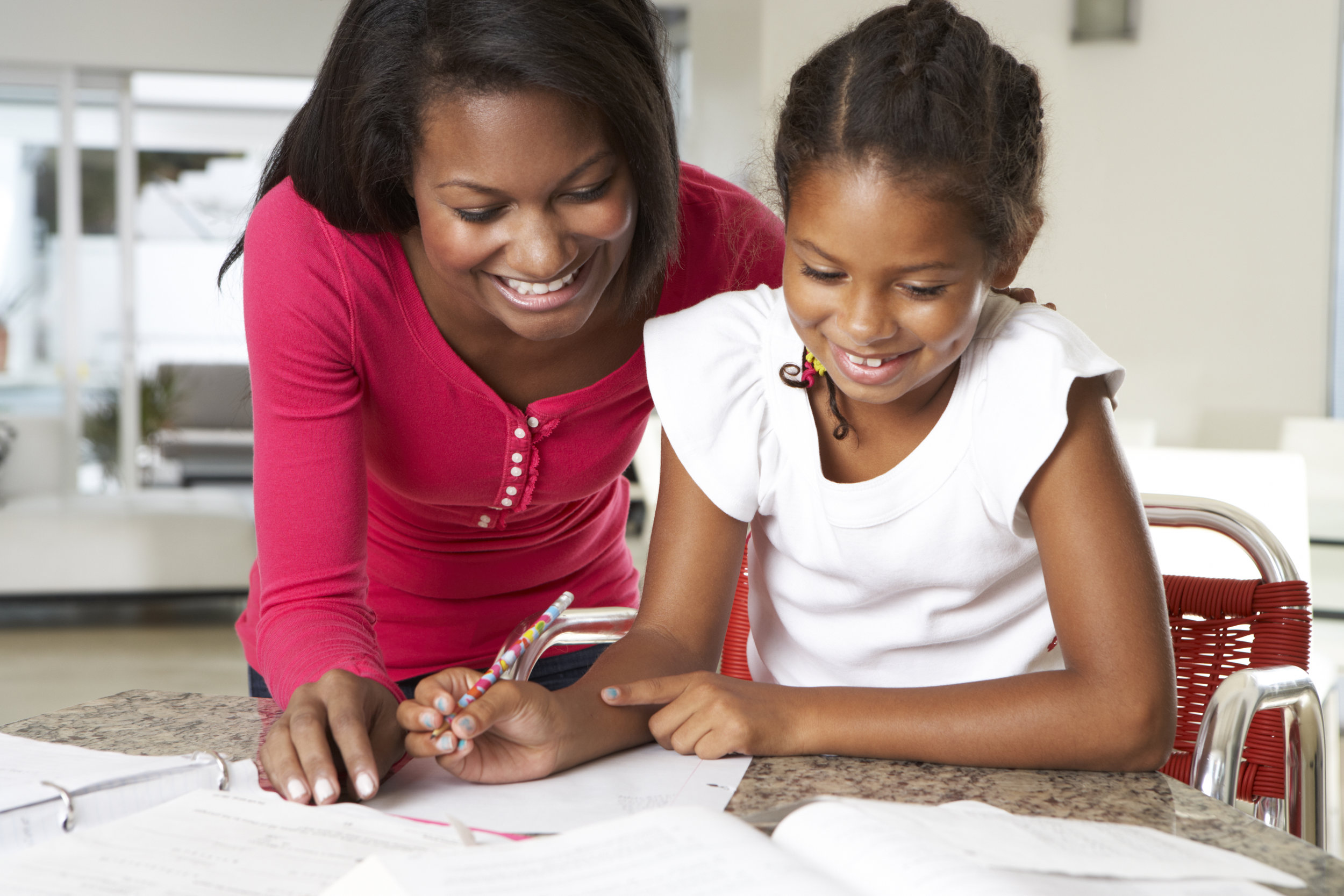 AA mom & daughter doing homework.jpg