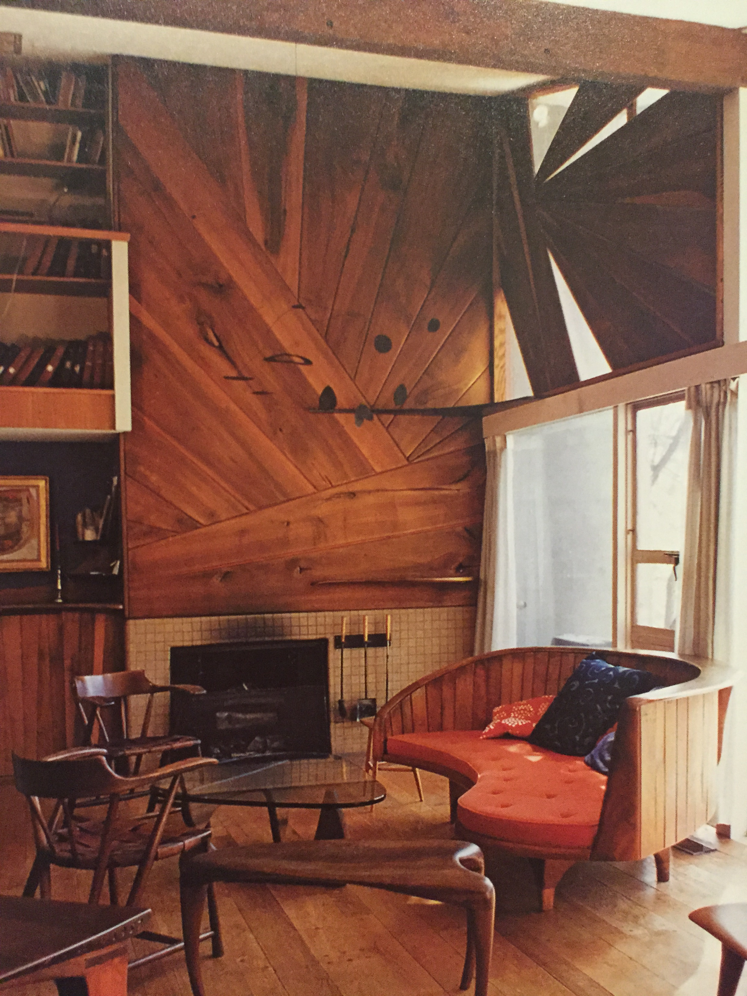 Chairs, table in foreground, sofa and wood paneling/sidingby W. Esherick.