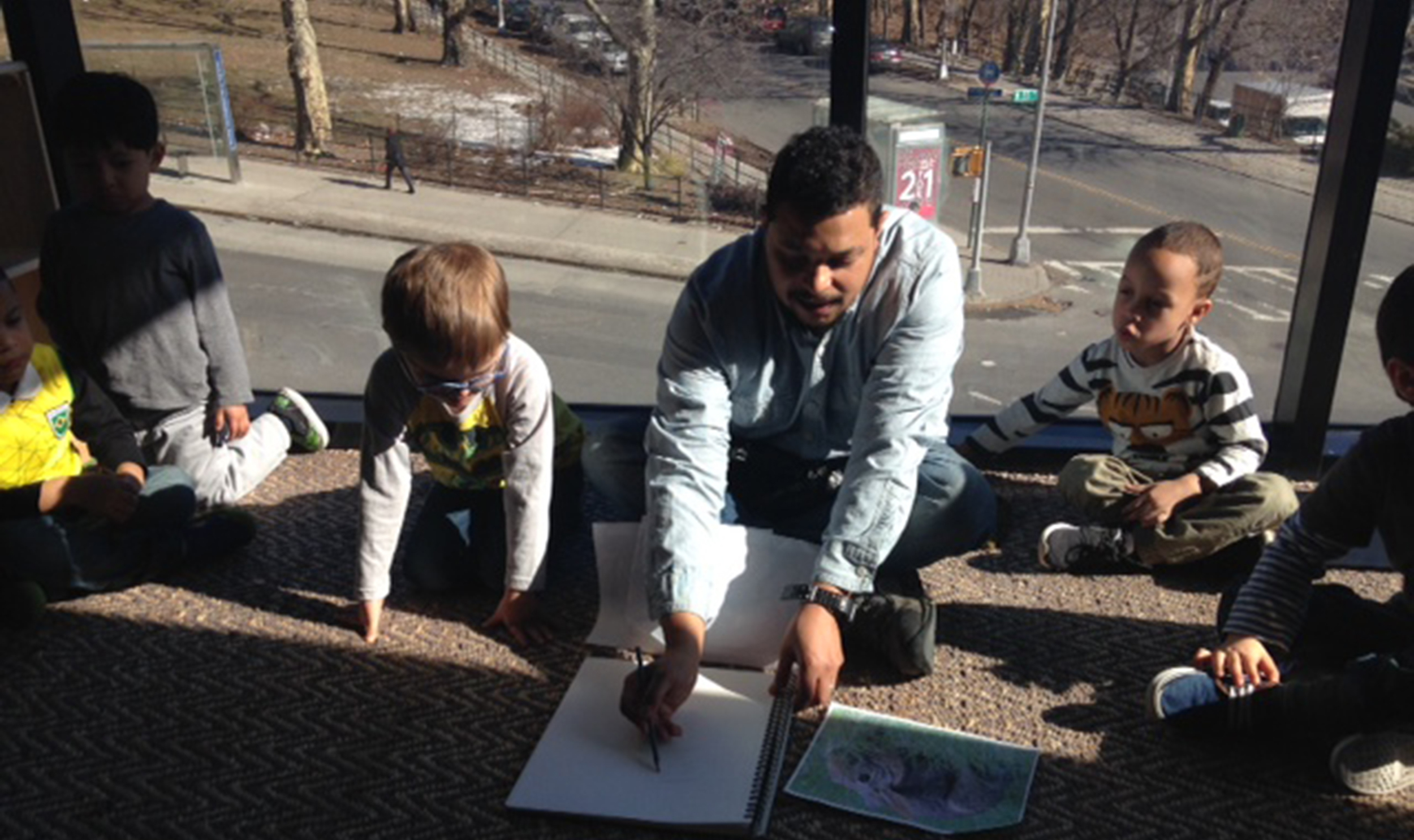 Artist-In-Residence David Shrobe with students at the Sugar Hill Museum Preschool.    Photo courtesy of Sugar Hill Museum Preschool.