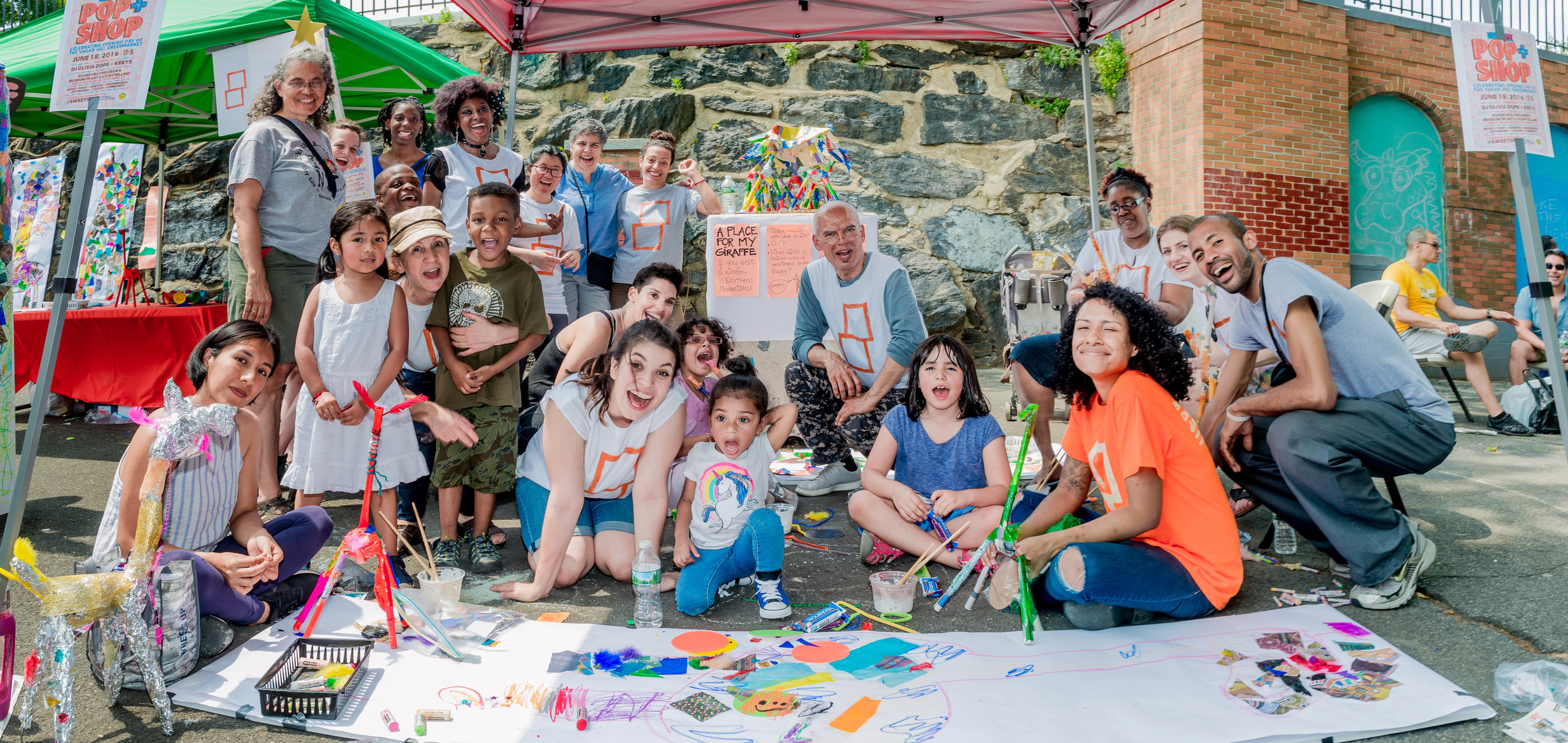Museum staff and volunteers welcome participants to their art-making station at Giraffe Path 2016