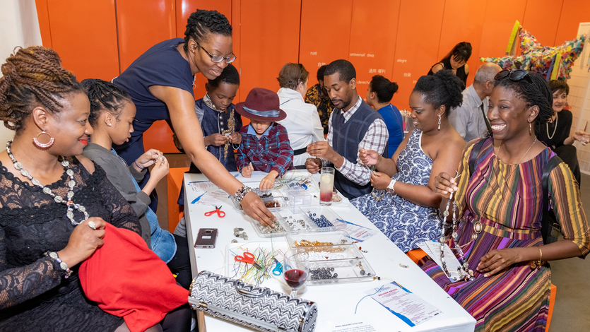 Guests making jewelry in the Studio Labs