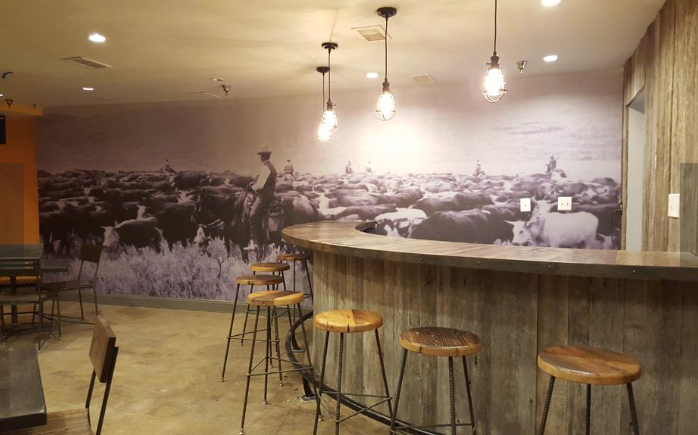 The back bar, which can be rented for private parties, features an old, blown-up photo from a cattle ranch. © Photo by Washington Business Journal