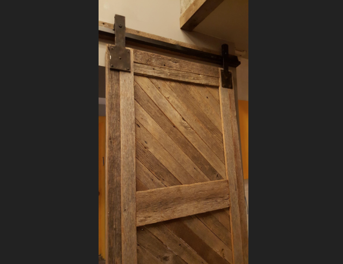 Sliding barn doors close off the back bar for private use. © Photo by Washington Business Journal