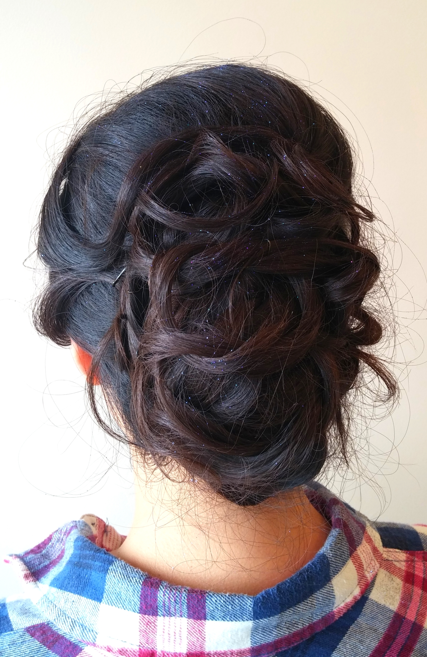 Mina's updo on her adorable client Joy!  Whether you may be planning on attending prom or cocktails with friends, everyone needs a fancy do once in a while. Come get styled by our team!