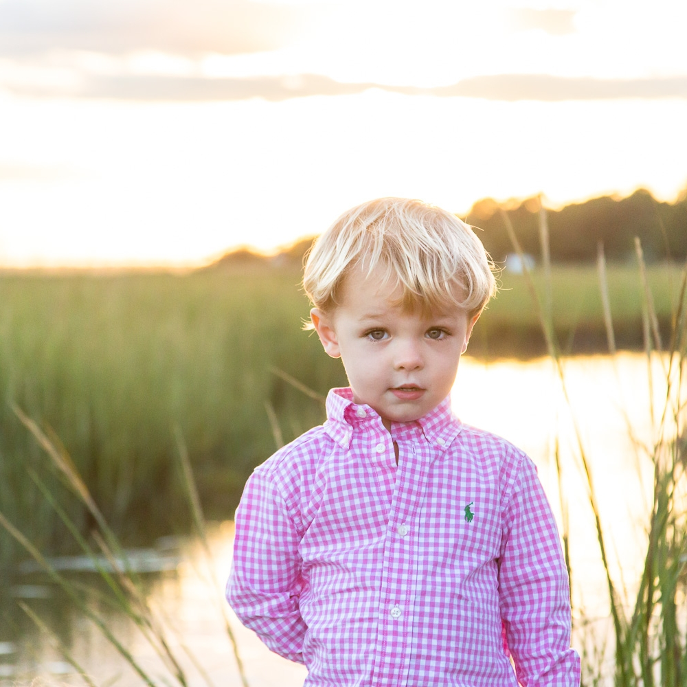 sea green photography, cynthia ragona, rhode island family photographer, rhode island beach photography, blonde boy with sea grass at sunset