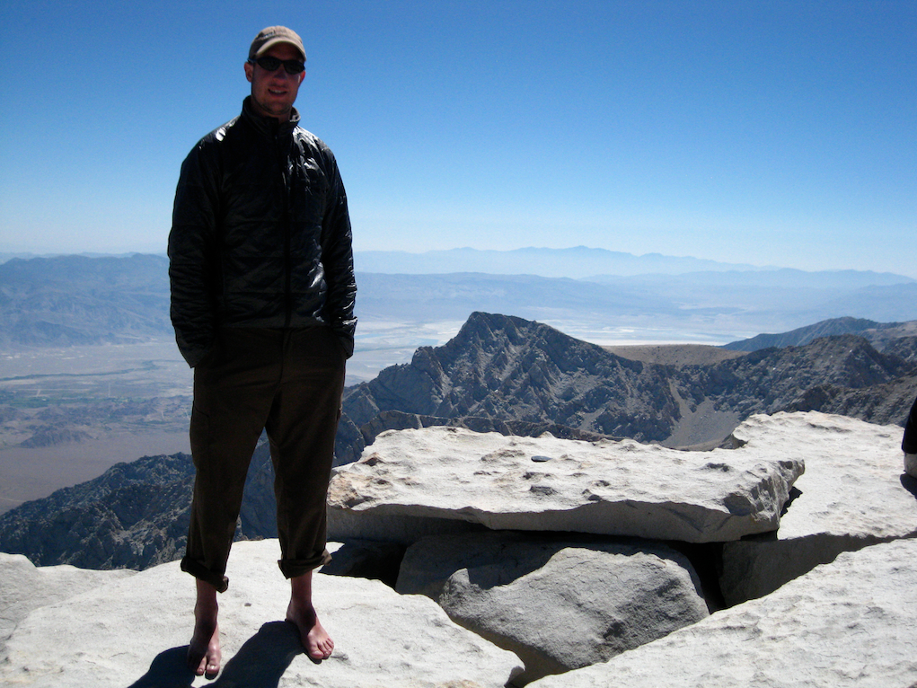 Standing on the summit of Mount Whitney
