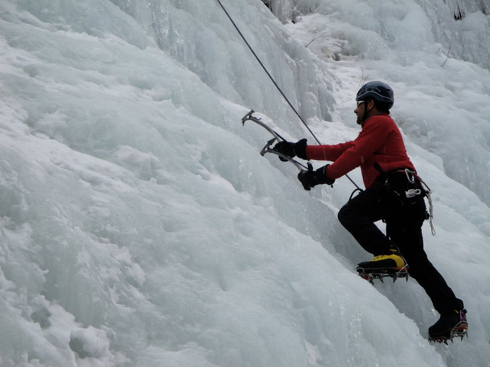 Ice climbing with ice tools and crampons