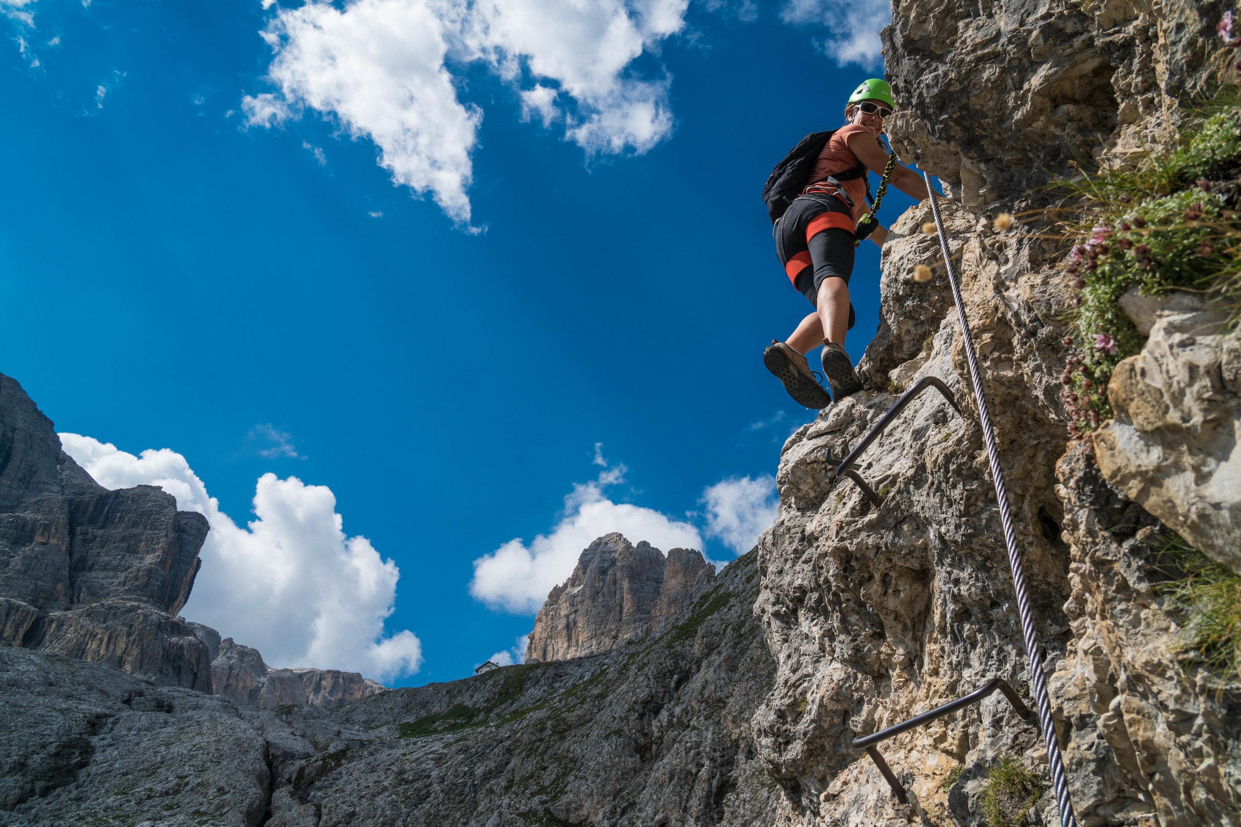 Climbing a via ferrata neat Falzorego Pass