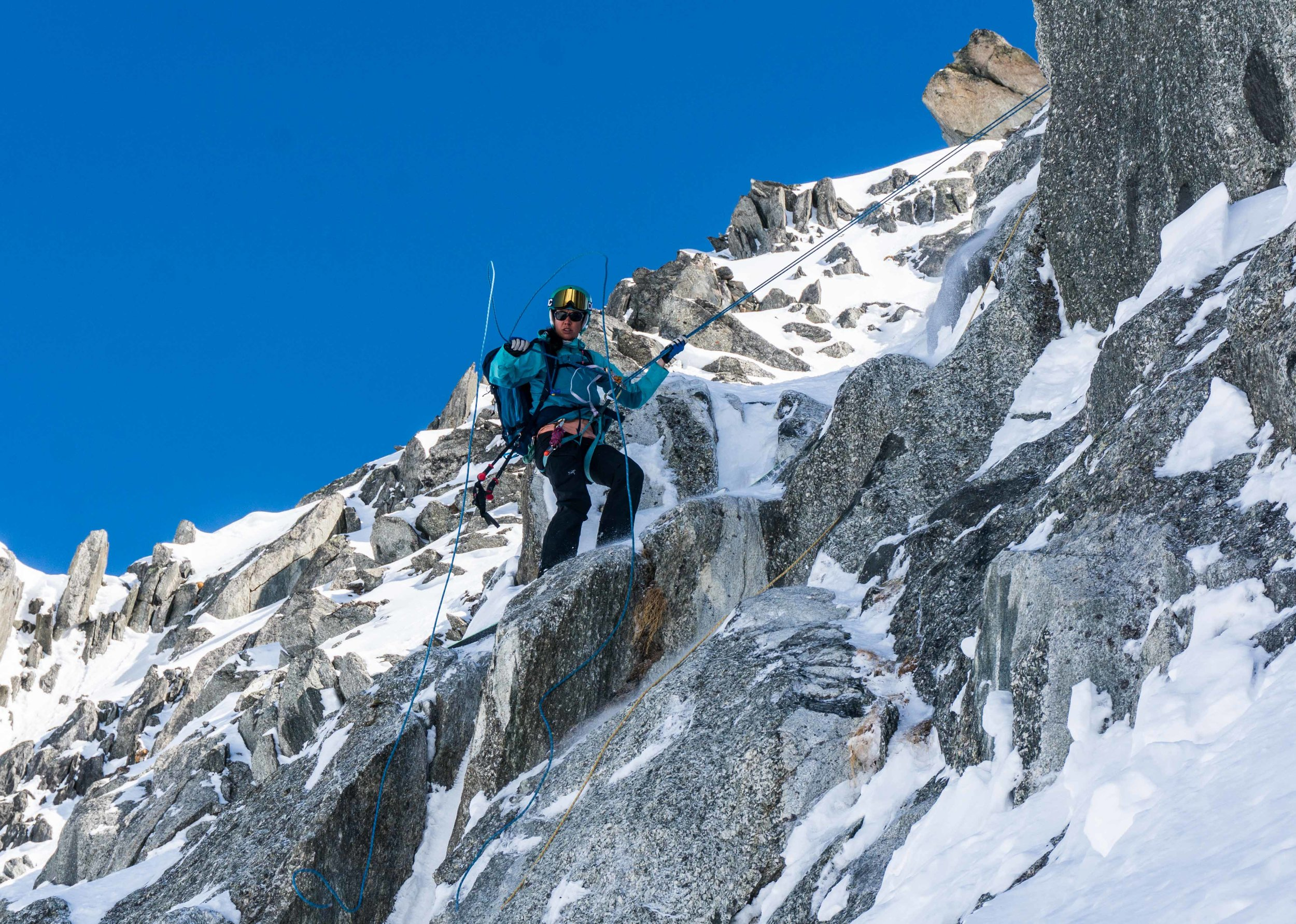 Rappelling into a ski line in Chamonix