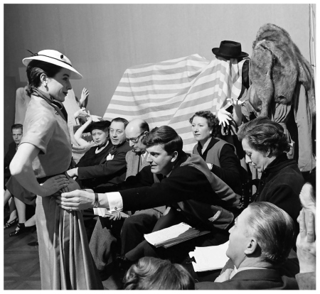 hubert-de-givenchy-adjusts-the-skirt-of-one-of-his-designs-on-bettina-for-his-first-spring-collection-photo-by-nat-farbman-feb-1952