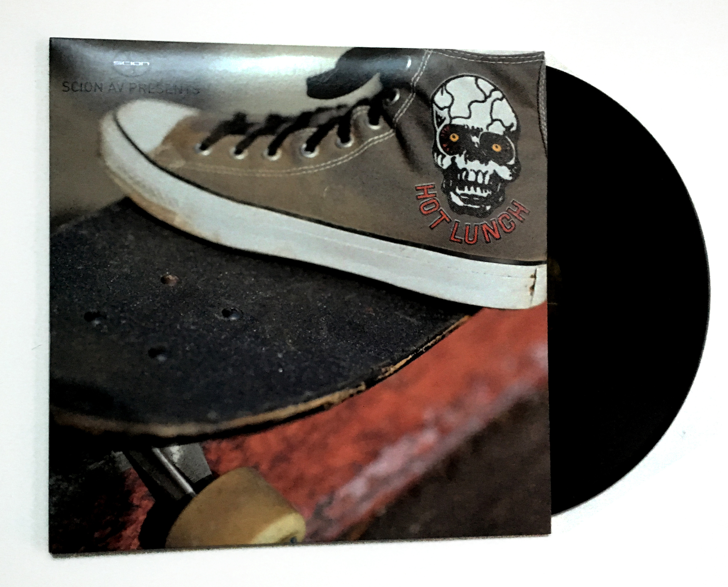 STARCADE DESIGNS CONVERSE SHOE FOR HOT LUNCH / SCION LP / PHOTO BY CHARLIE CARR      .