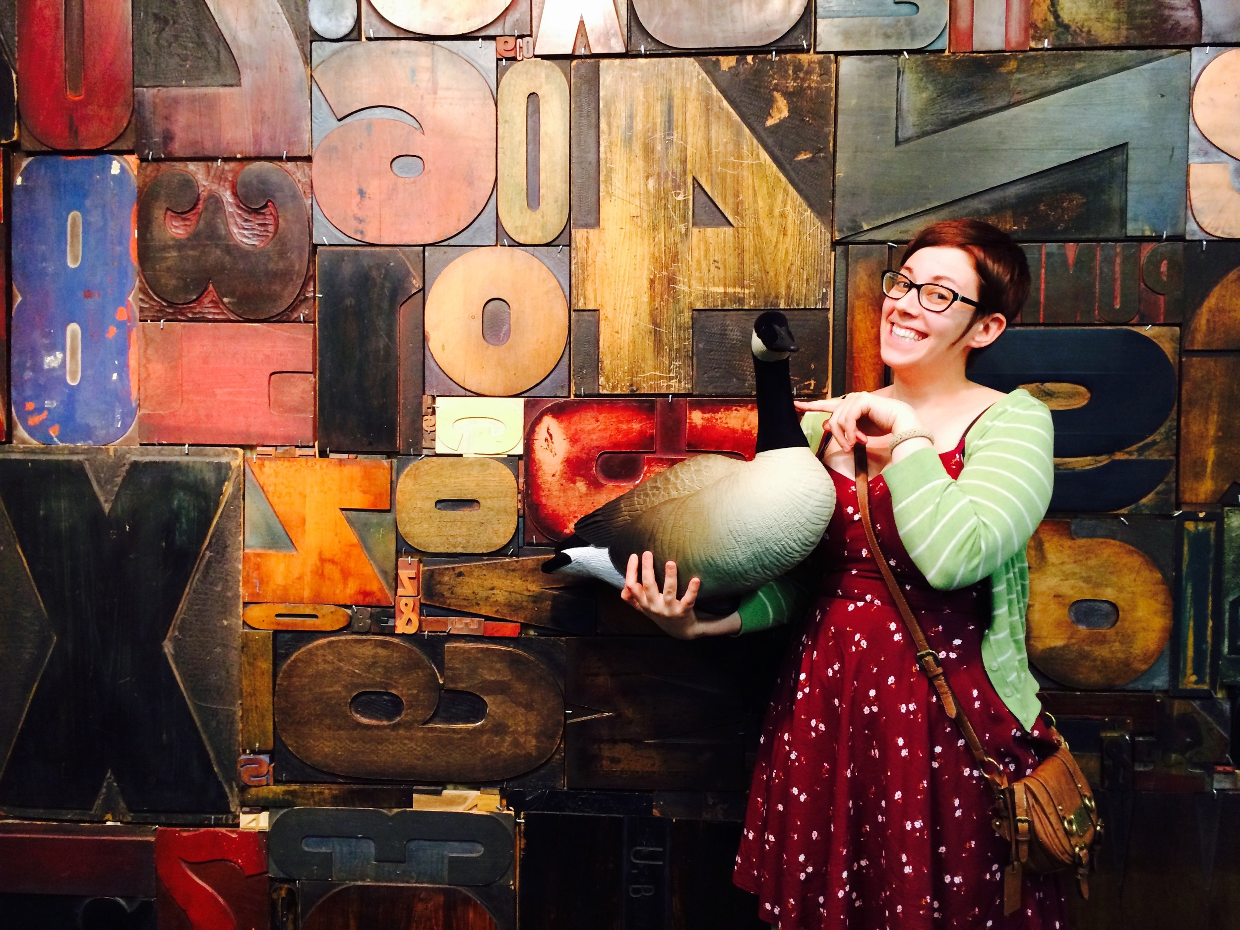 Alyse, pictured here with the ever elusive Wayz Goose at the 2015 Hamilton Woodtype Museum Wayzgoose. And yes, that is a giant wall of woodtype.