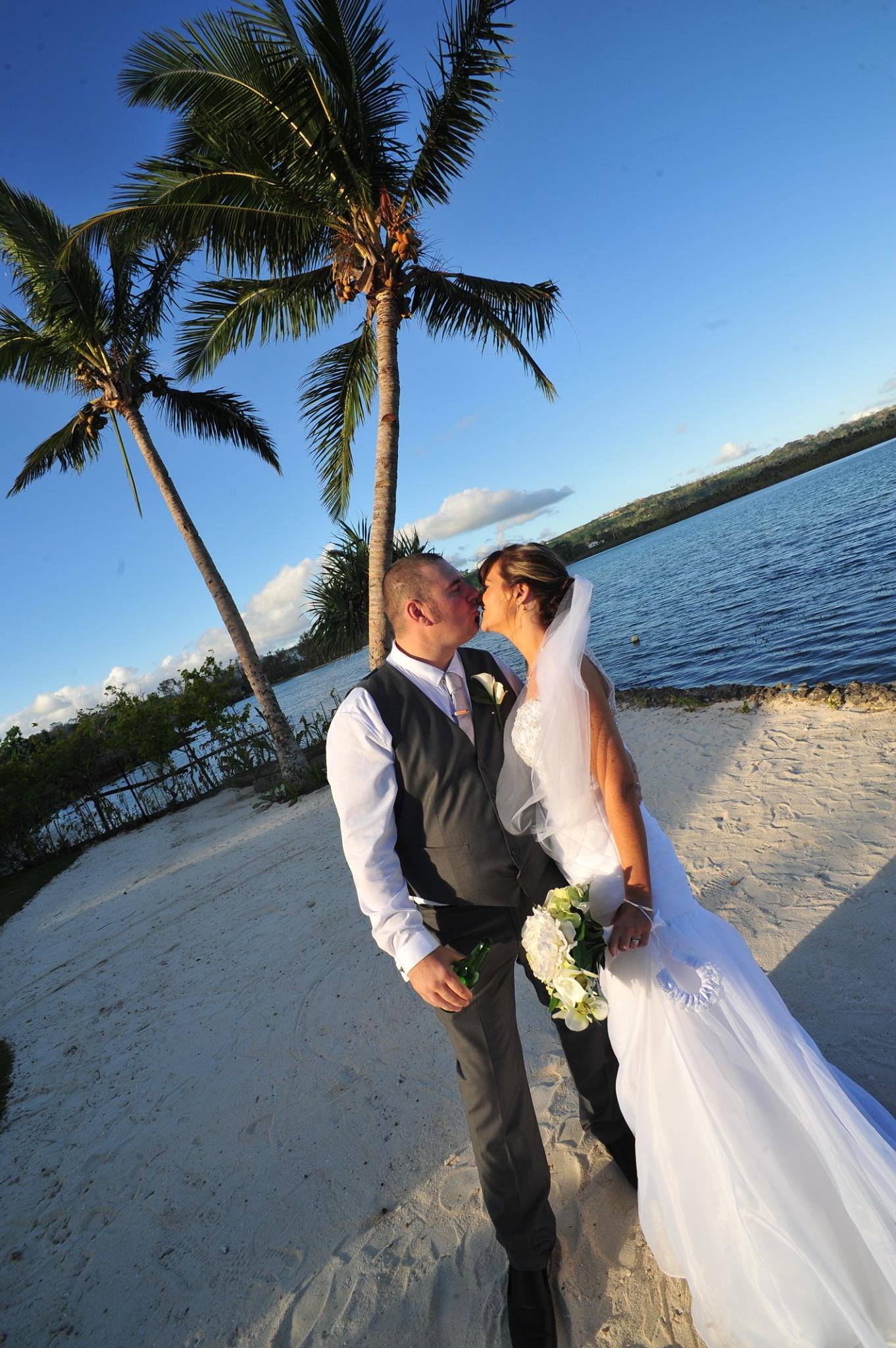 DC - Bride and Groom kiss beachfront.jpg