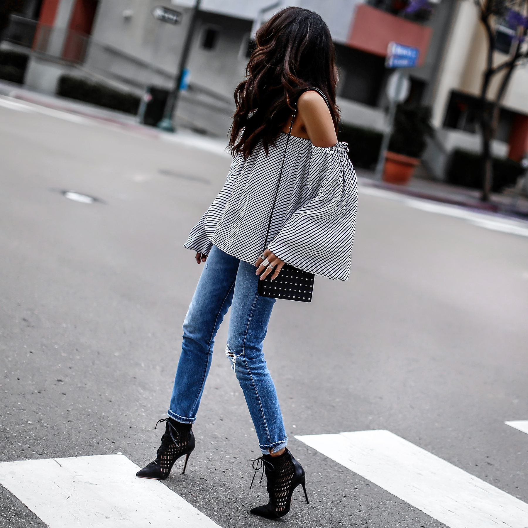 High_Rise_Distressed_Levis_Jeans_MLM_Striped_Off_The_Shoulder_Top_Alexander_Wang_Studded_Bag_Schutz_Lace_Up_Boots.jpg