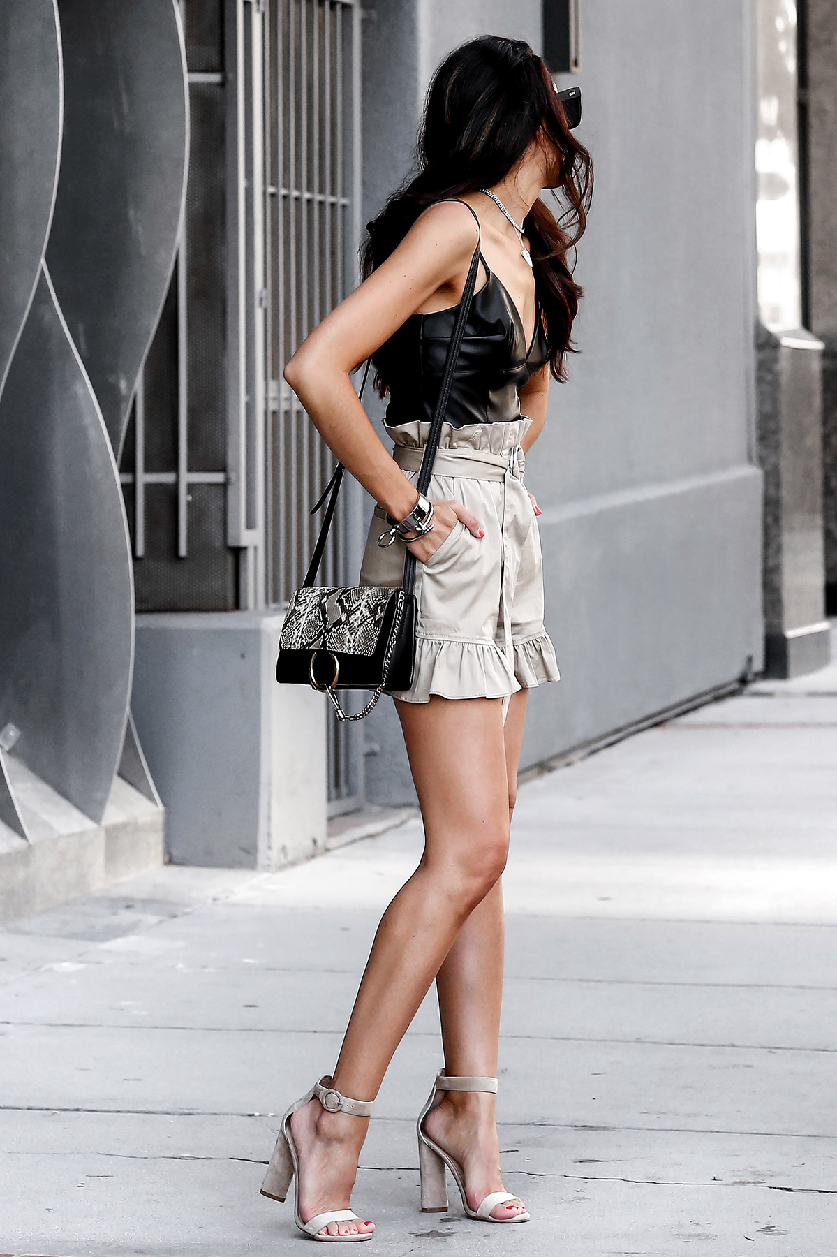 Cinq_E_Sept_Ruffle_Shorts_Express_Leather_Crop_Top_Chloe_Faye_Bag_Kendall_and_Kylie_Sandals.jpg
