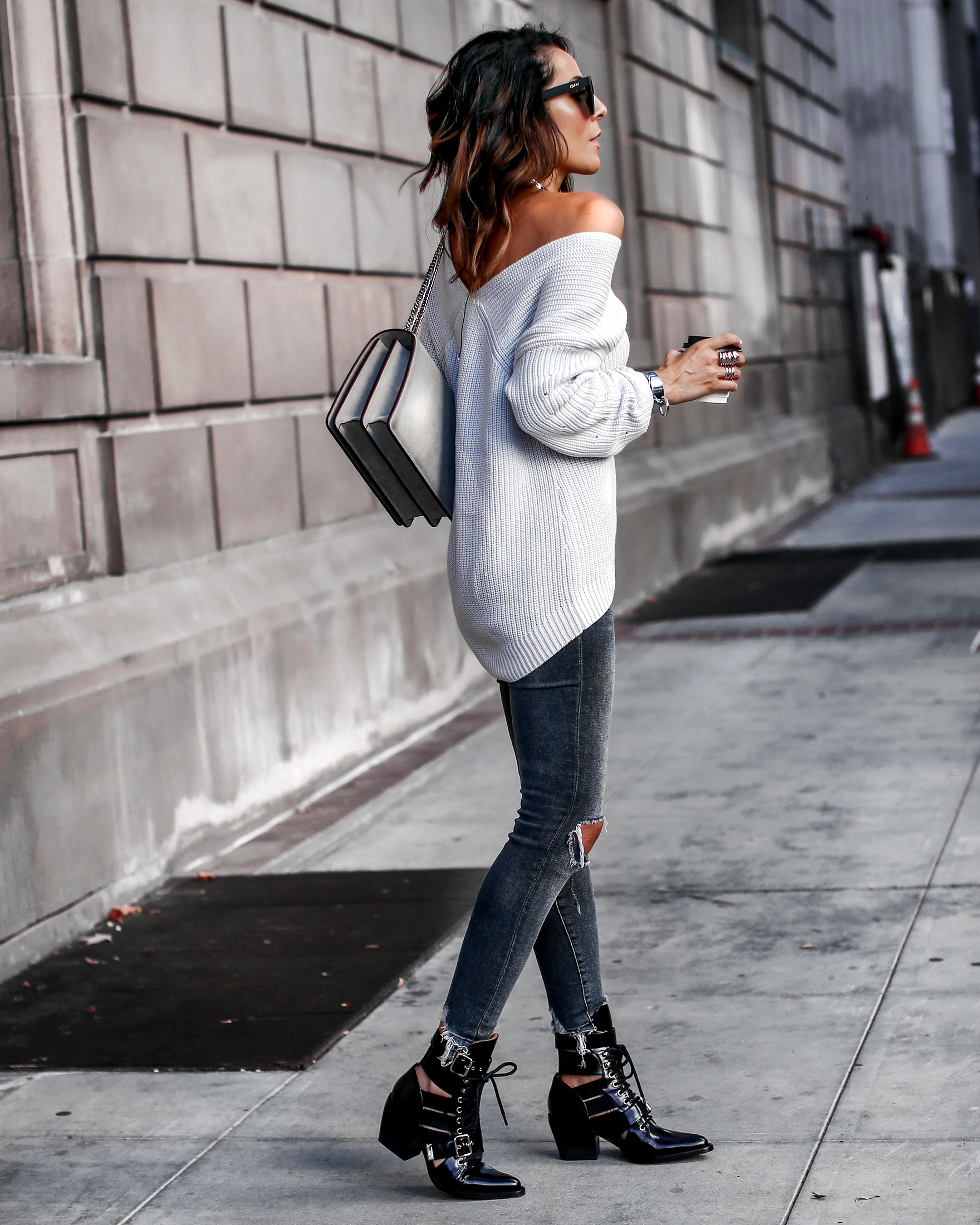 Lucys Whims Brunnette Woman Wearing Off the Shoulder 525 Sweater DL1961 Ripped Jeans  Chloe Rylee Boots Agneel Shoulder Bag.jpg