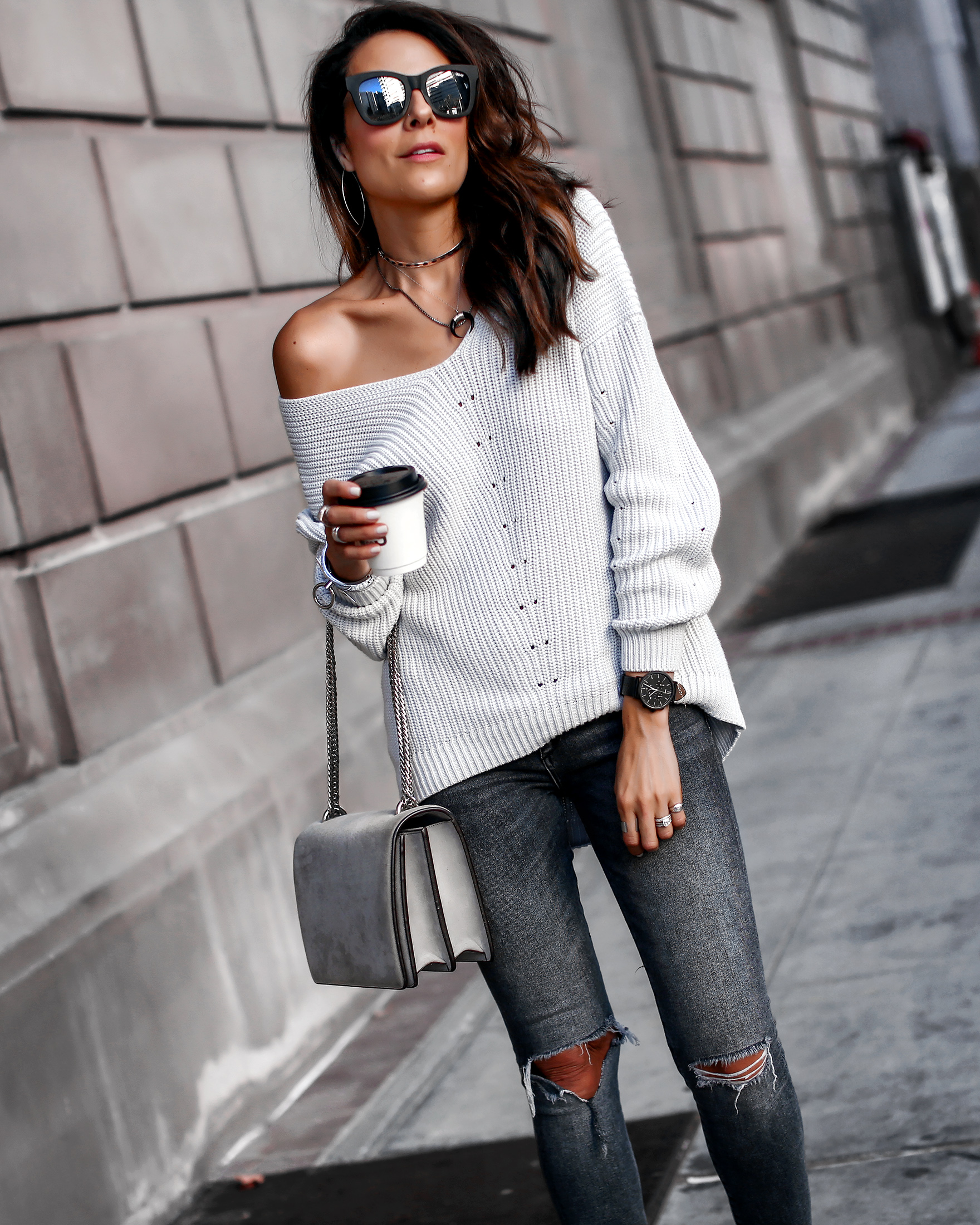 Lucys Whims Brunnette Woman Wearing Off the Shoulder 525 Sweater DL1961 Ripped Jeans Agneel Shoulder Bag.jpg