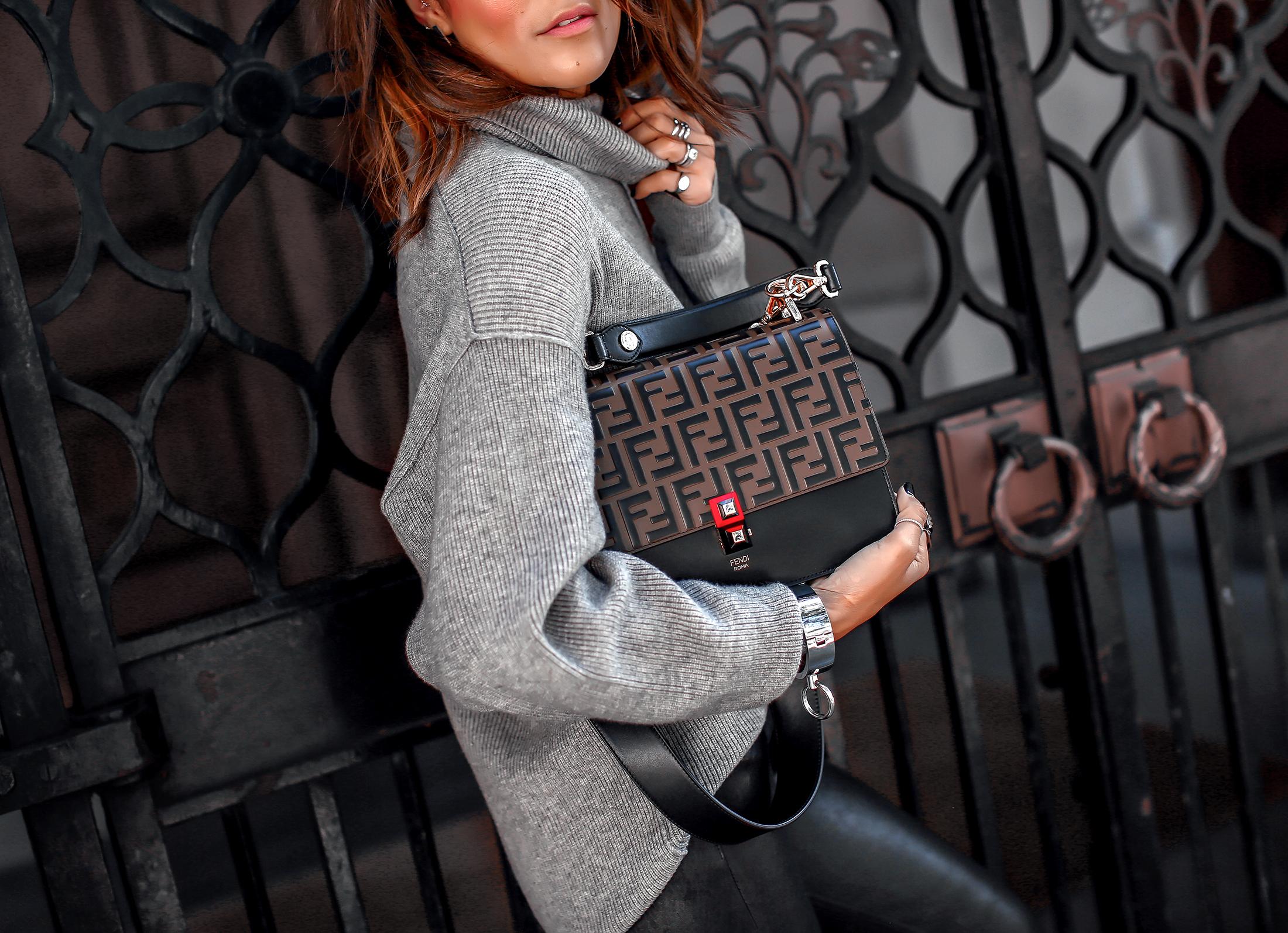 Brunette Woman Holding Handbag